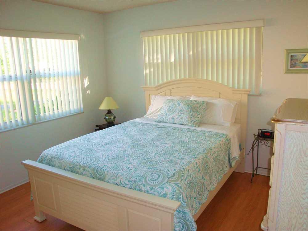 Second bedroom has queen bed, double closet plus full dresse