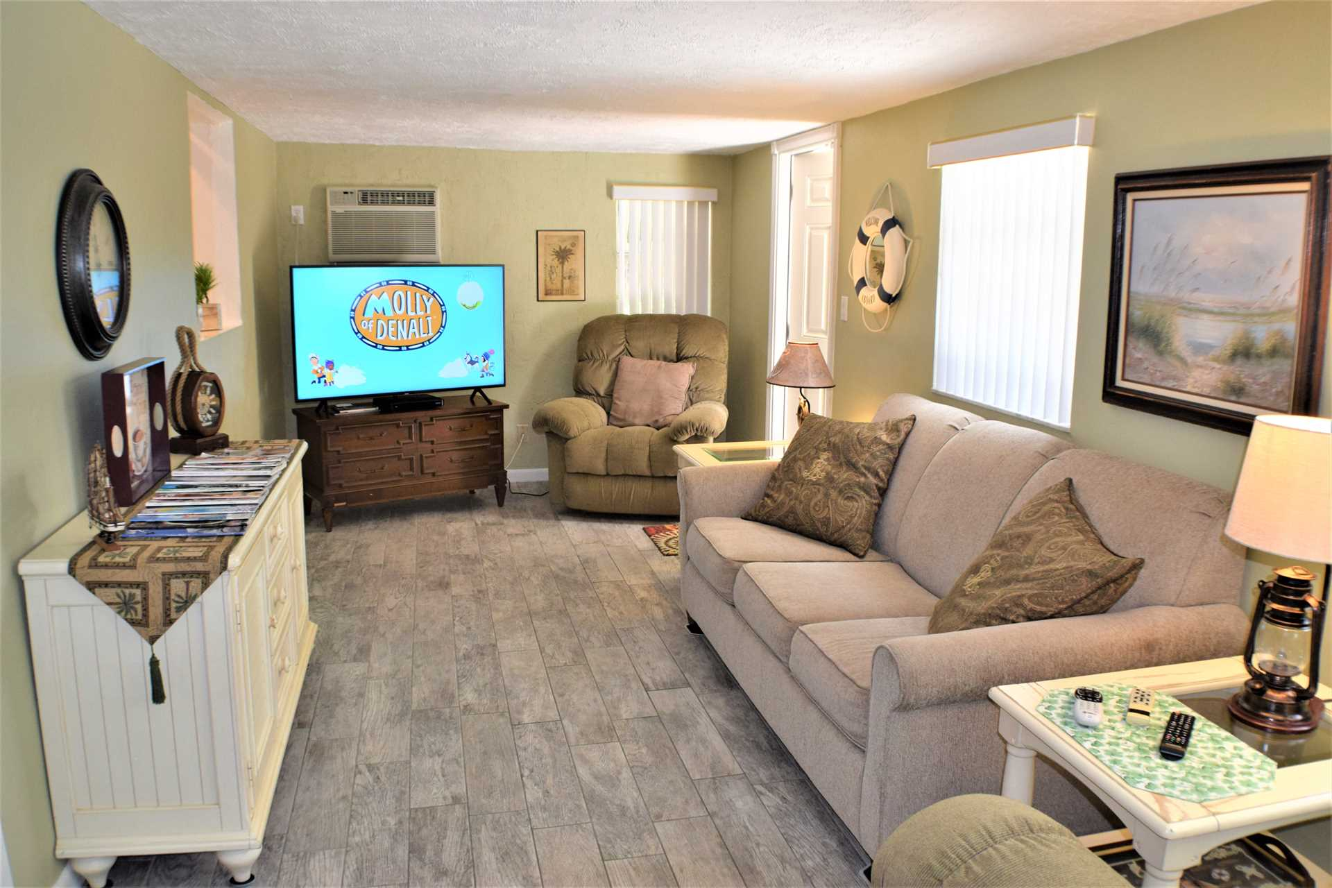Florida room features HDTV and convertible sofabed.