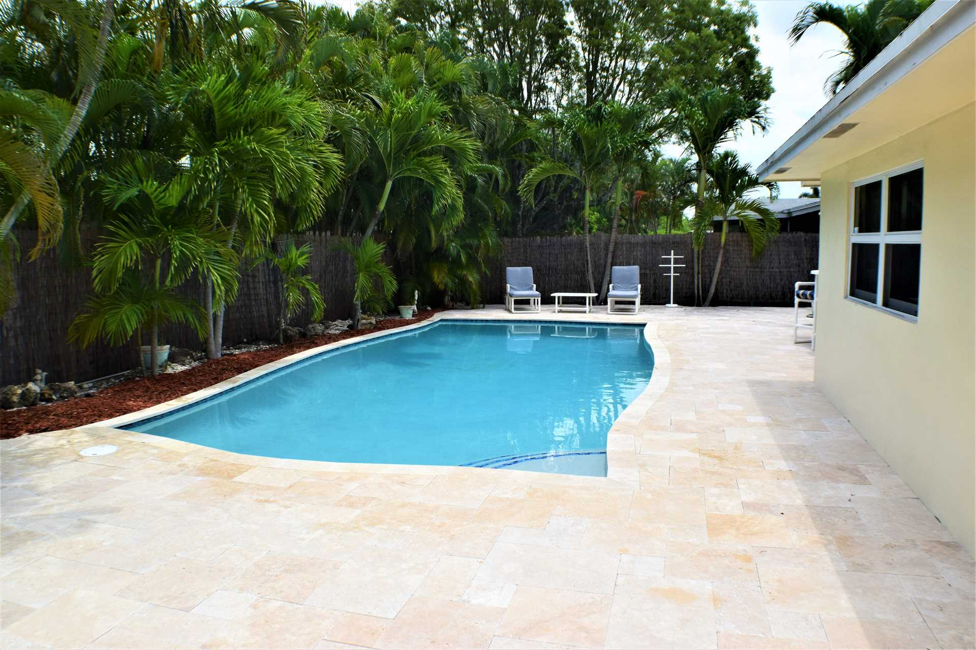Pool and deck are enclosed with six foot privacy fence.