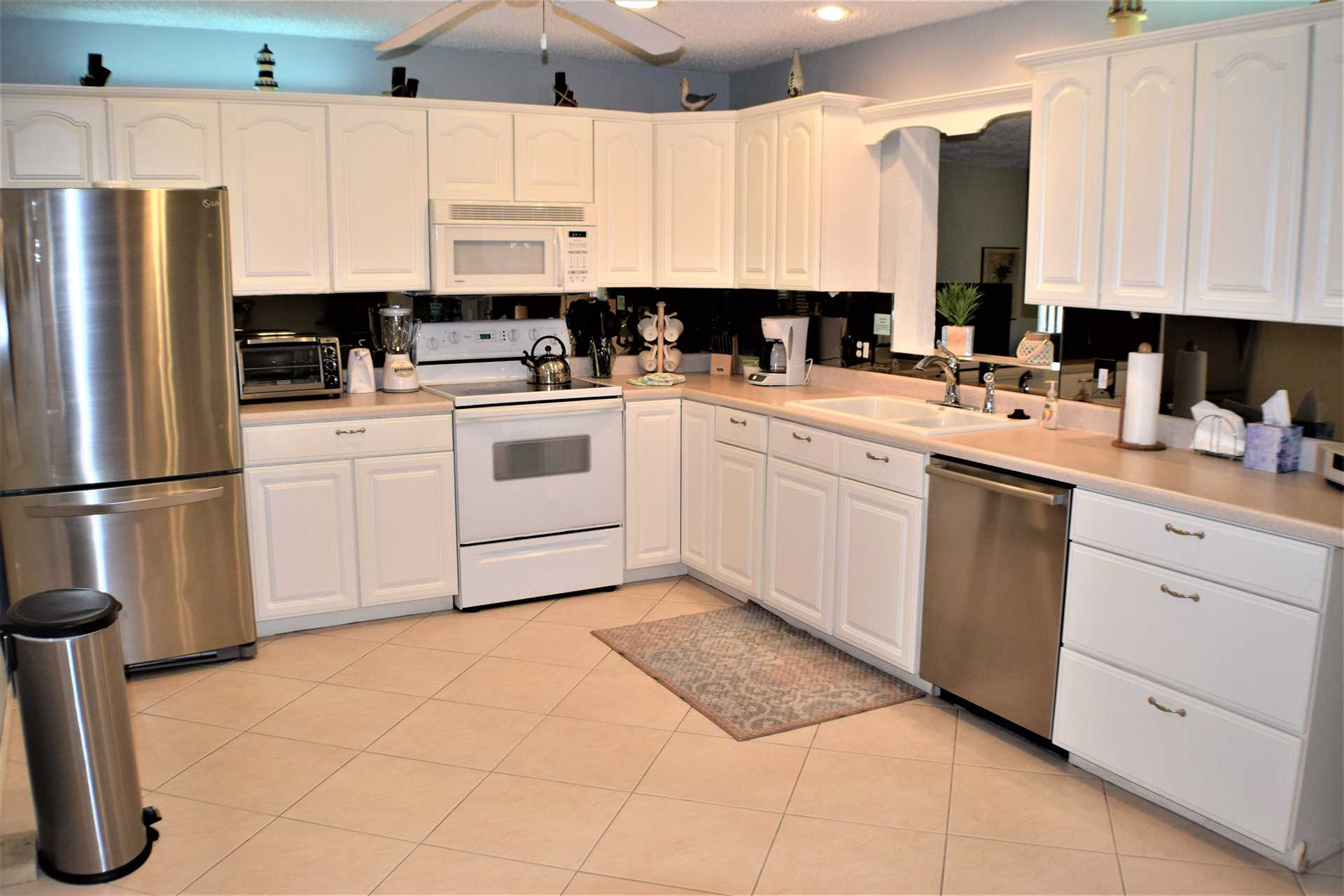Kitchen is fully equipped with dishware, cookware and every