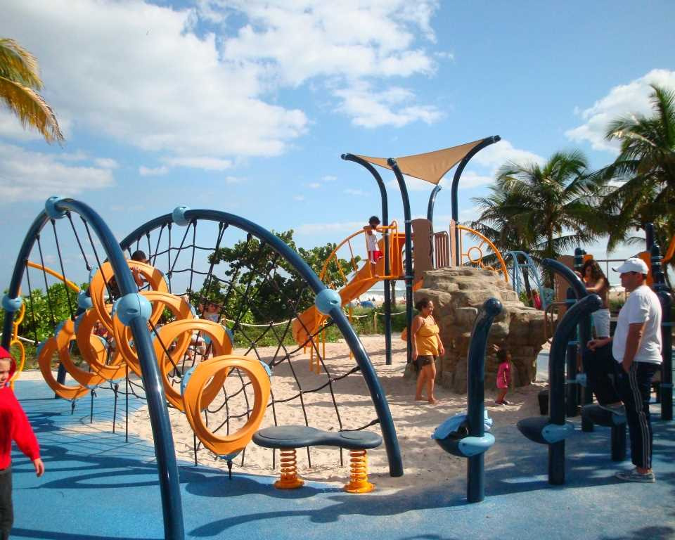 A kid's playground is at one of the beach entrances.