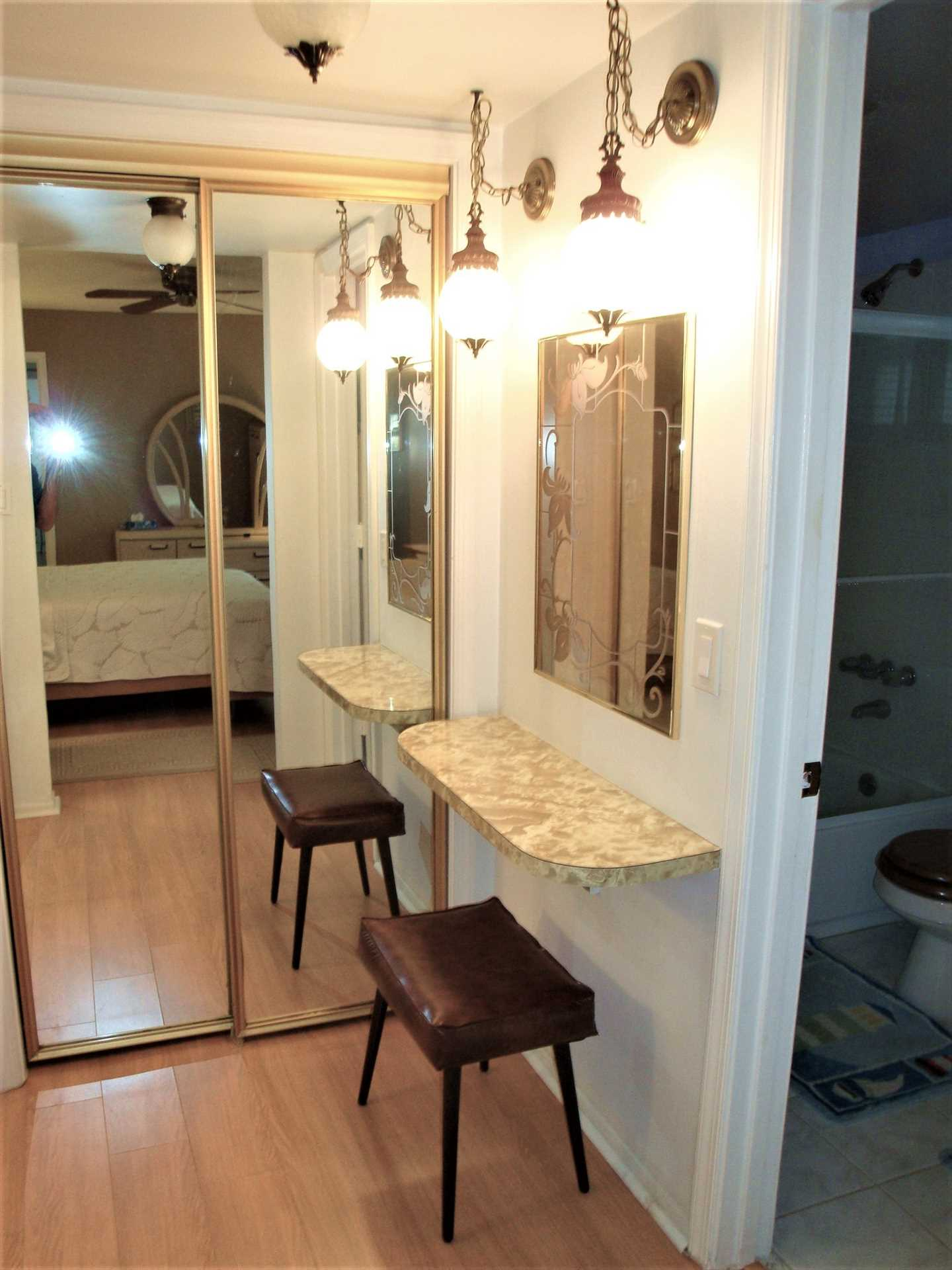 Master bedroom has large closets and vanity.