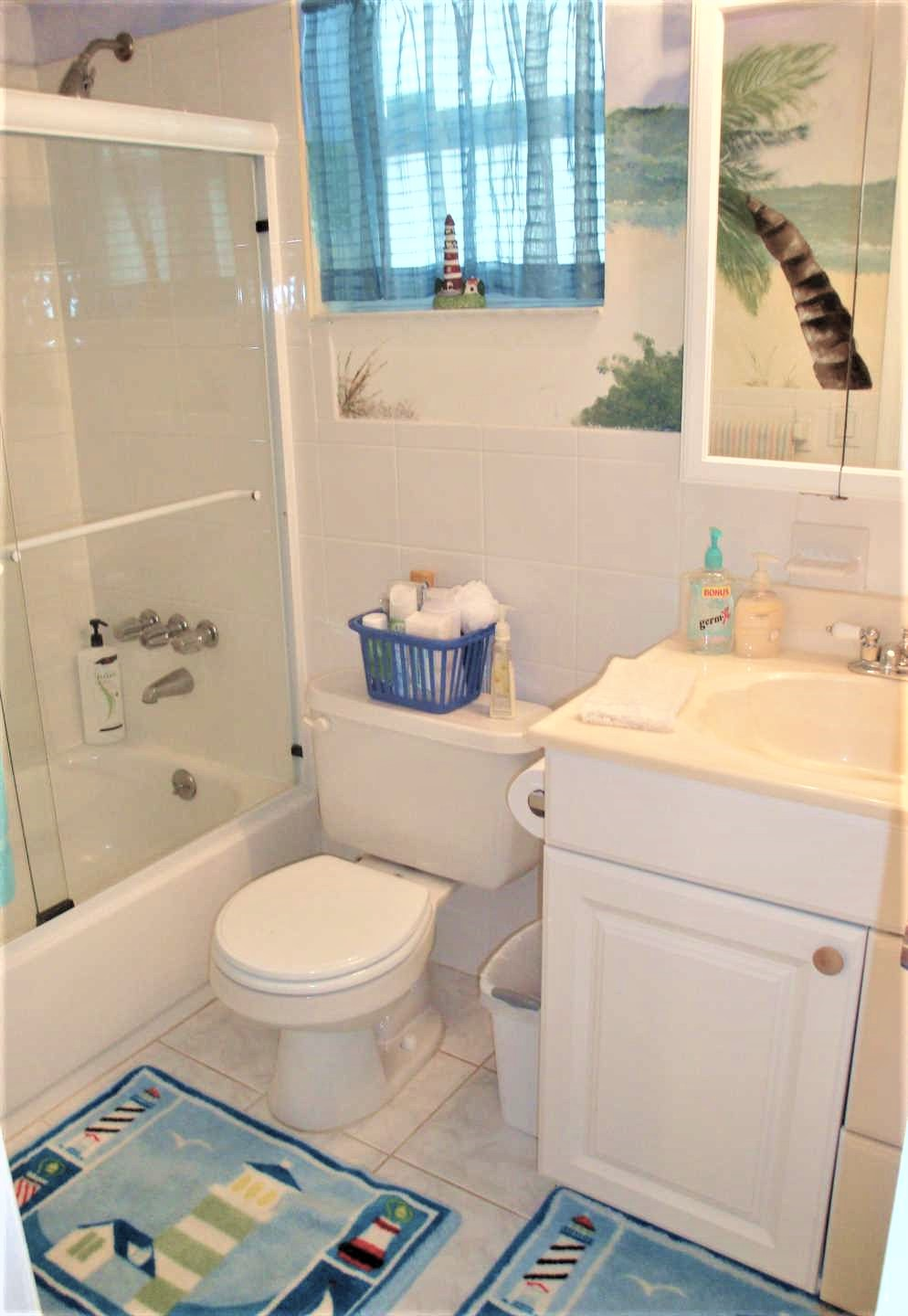 Master bath has combination tub and shower.