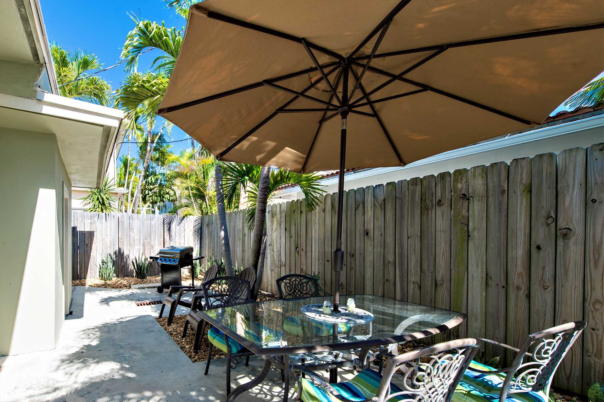 Dine at one of the patio tables and enjoy the South Florida