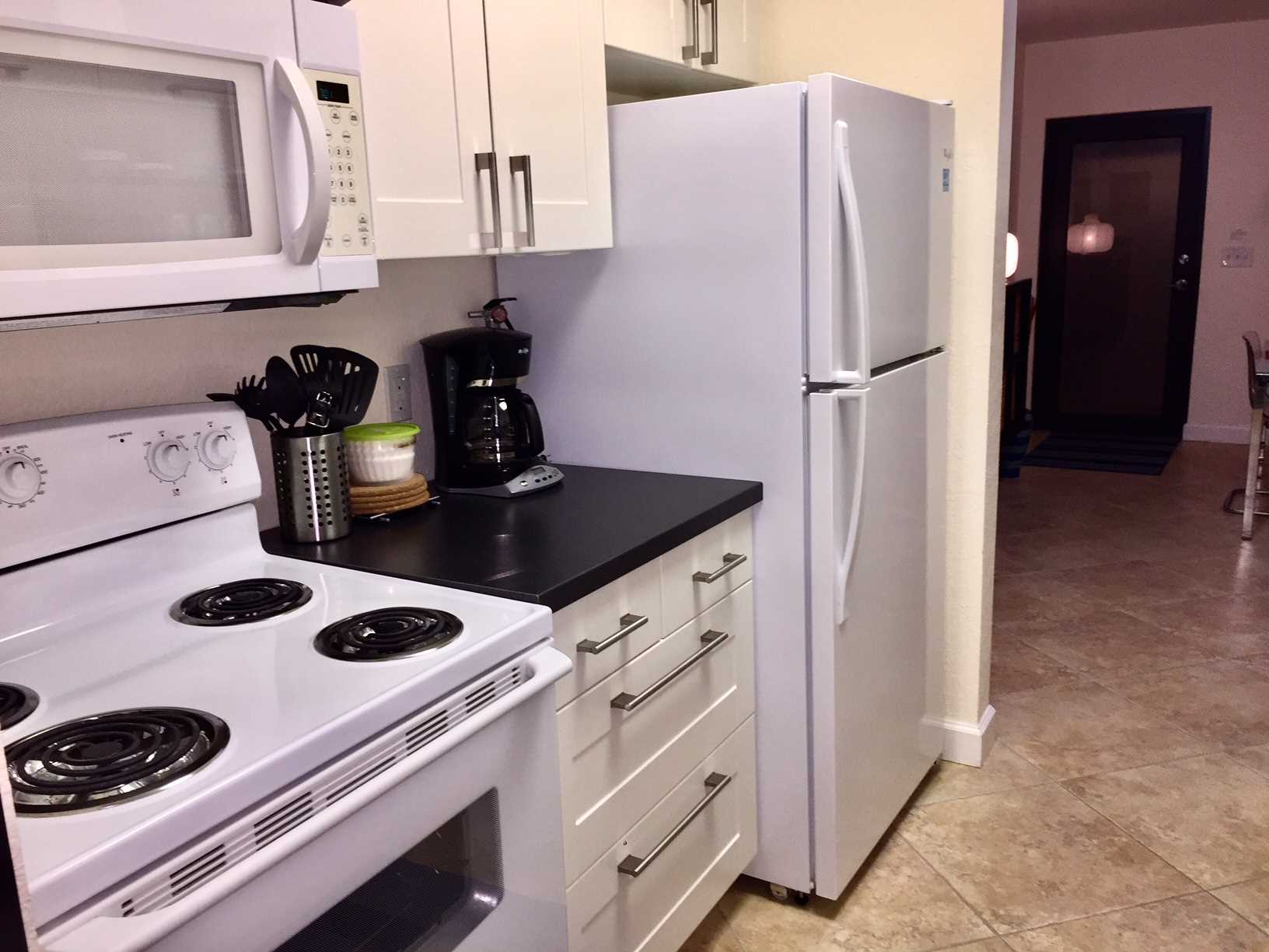 Kitchen has all new appliances including built-in microwave.