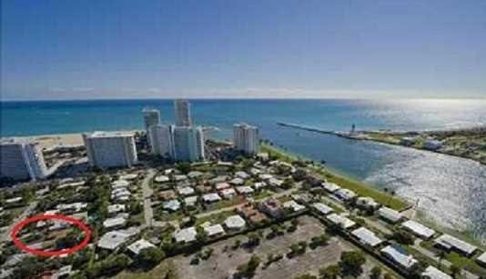 The home is located next to the Port Everglades main channel