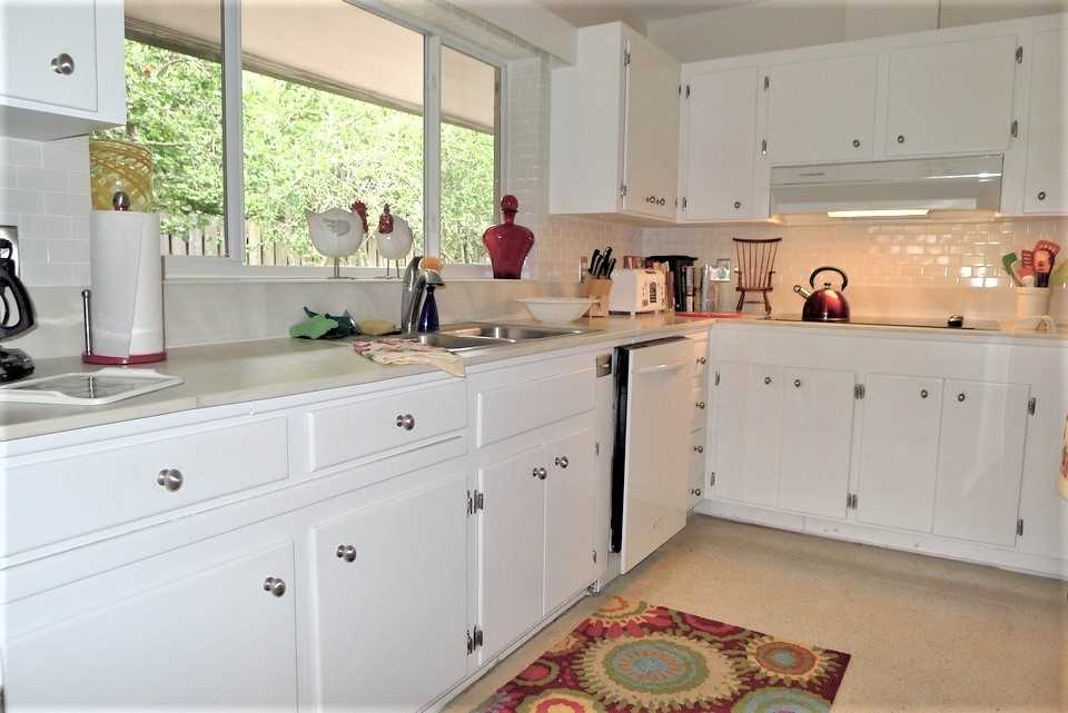 Kithcen features full appliances, dishes, silverware and coo