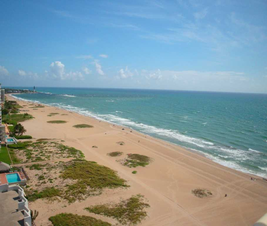 The warm ocean breezes , sand and surf await your arrival!
