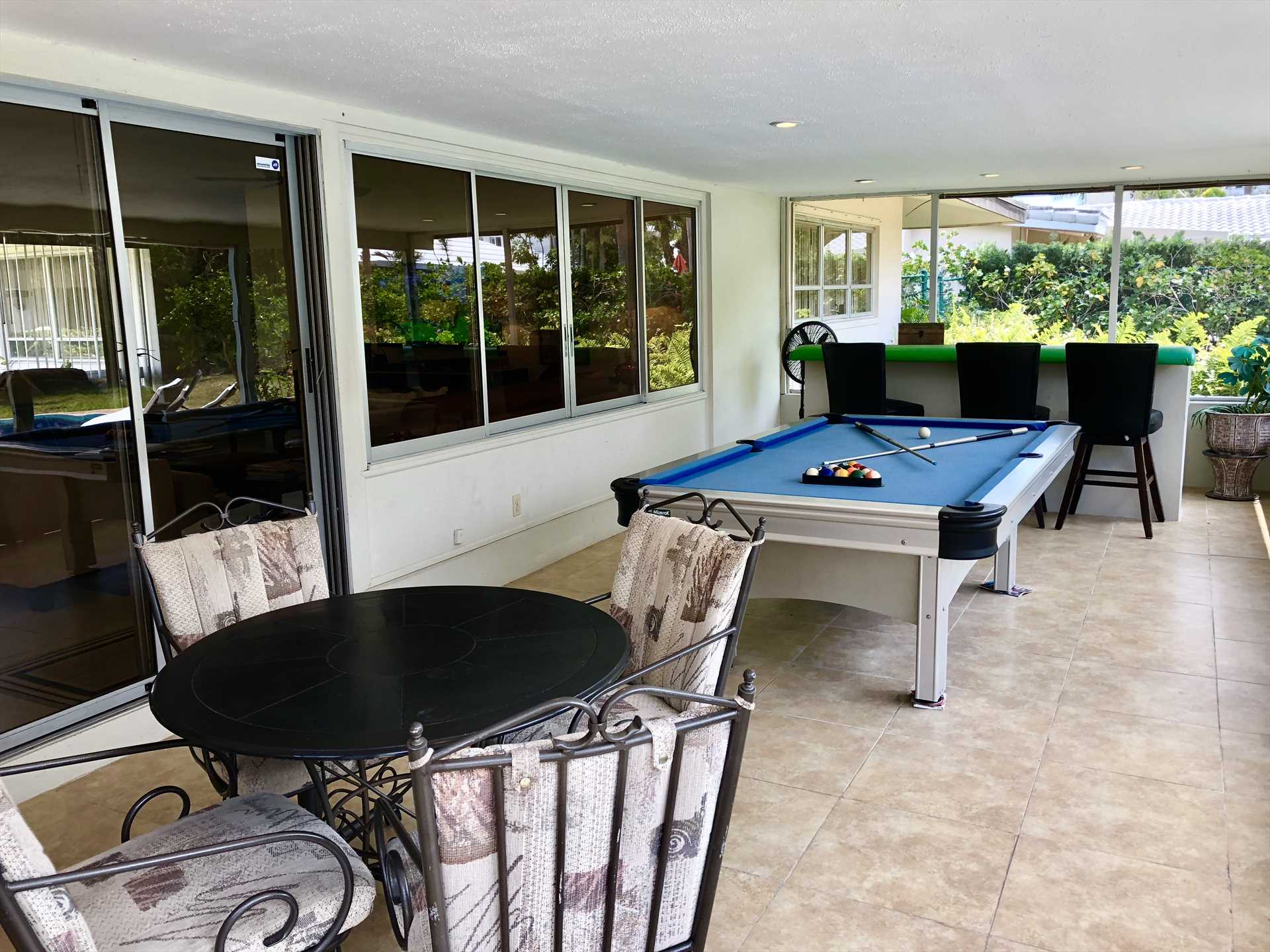 Lanai features card table and bar area.