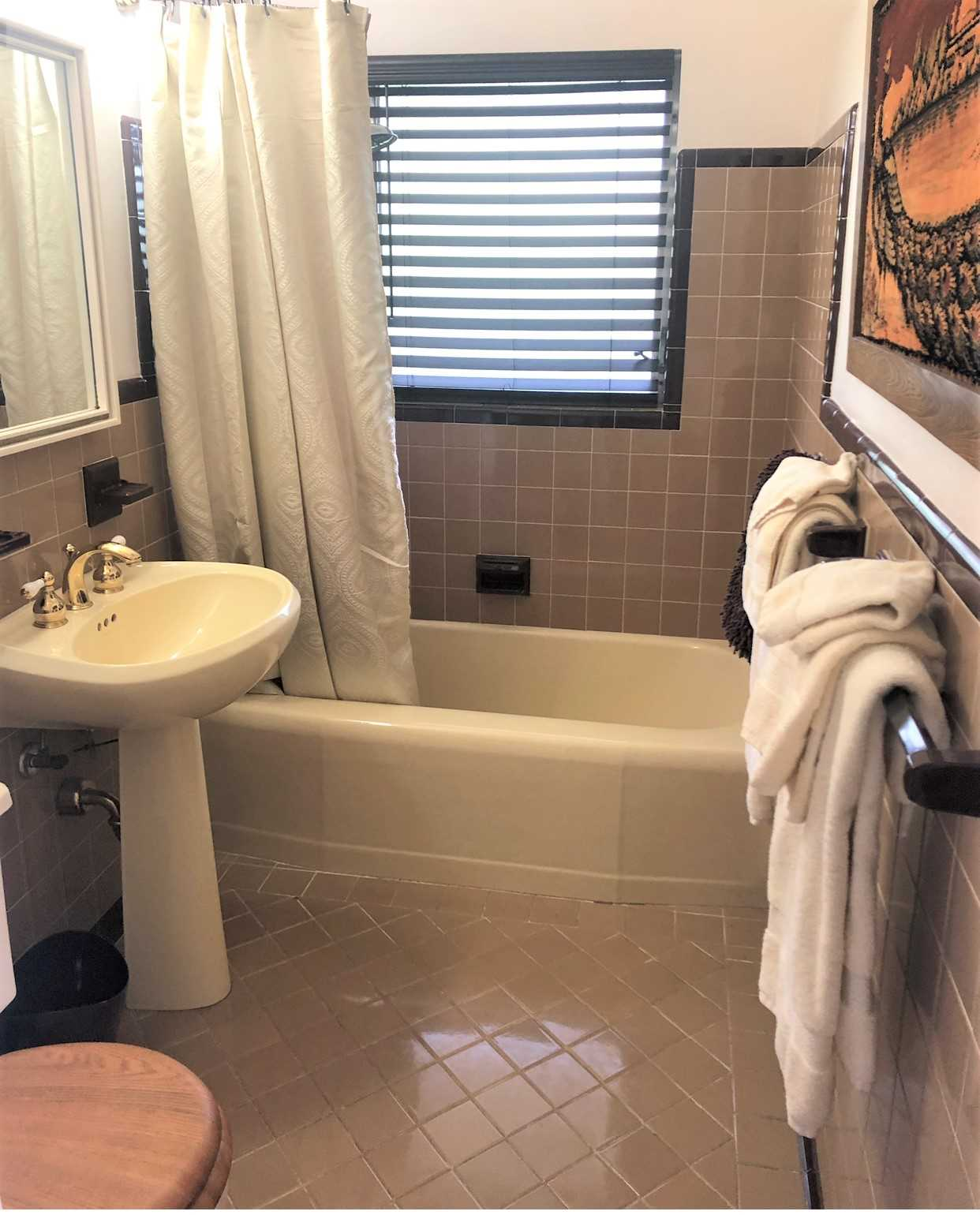 Master bath has combo tub and shower..