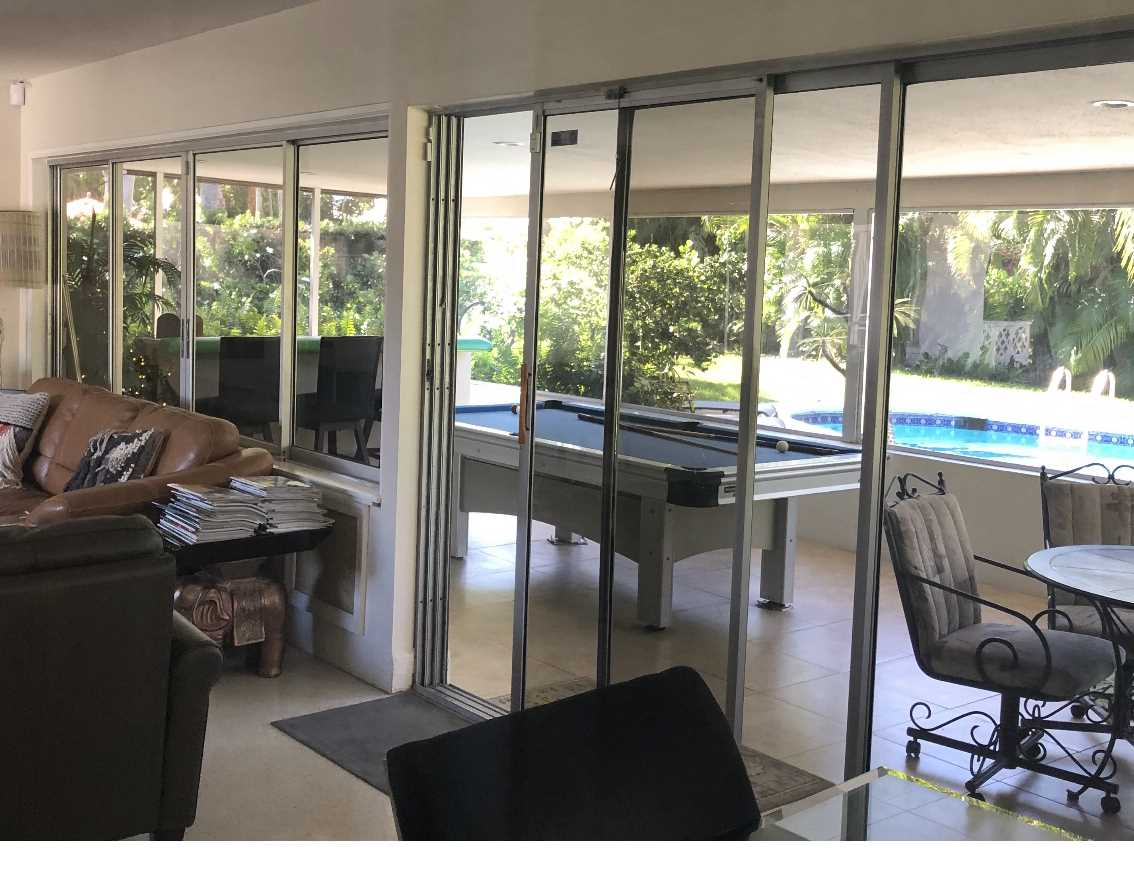 Open living area opens to lanai and pool deck.