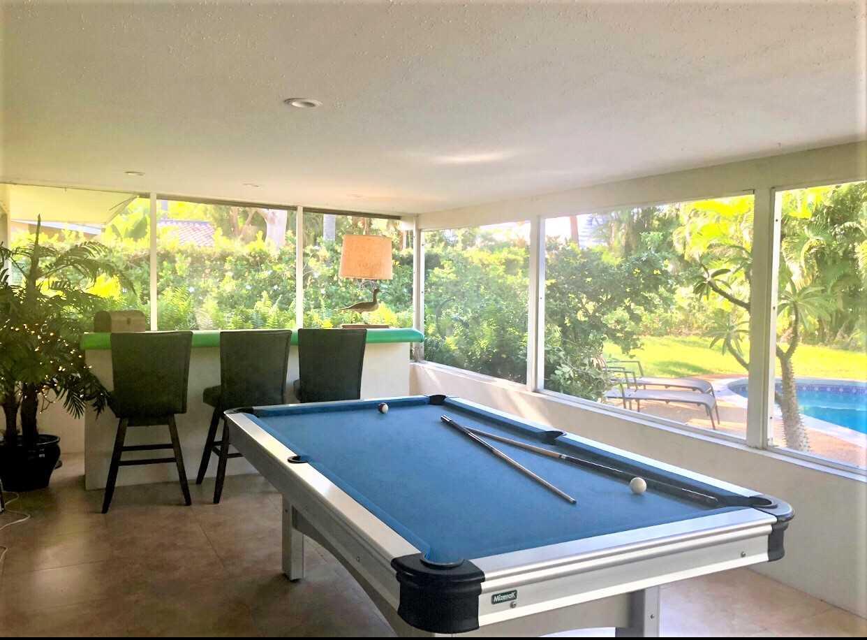 Enjoy a game of pool in the lanai.