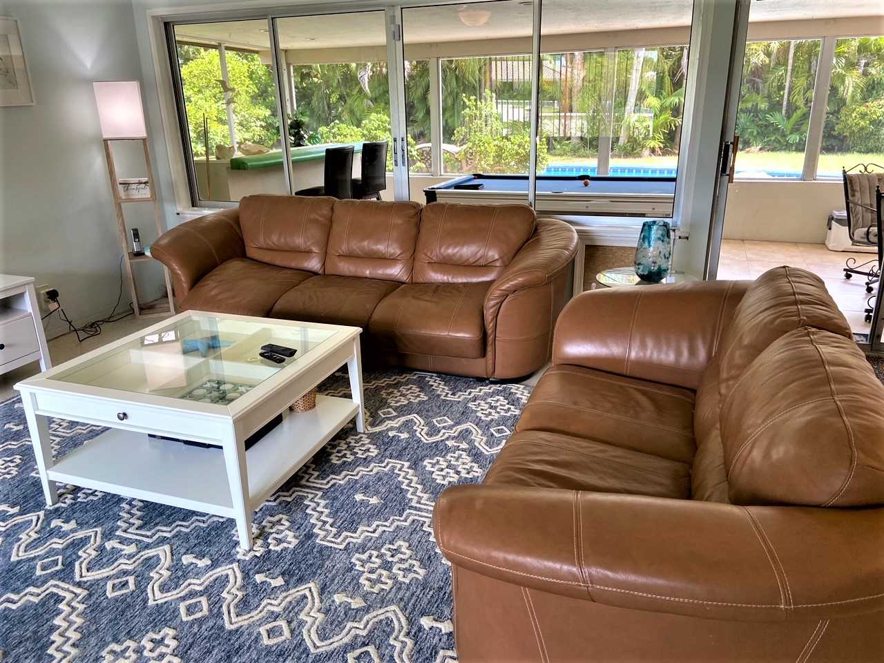 Living area has leather furniture and queen size pull out so