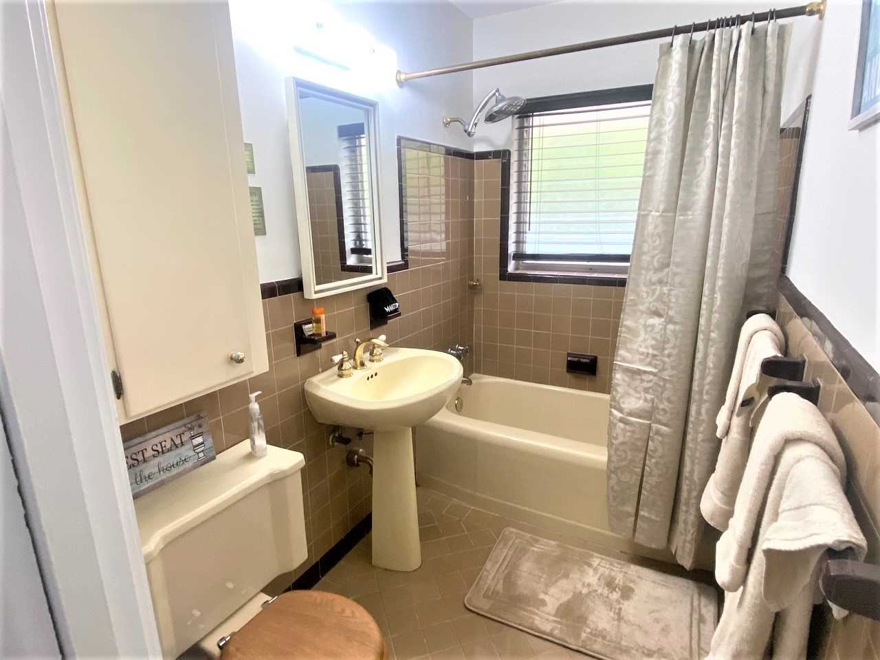 Master bath ensuite has combo tub/shower.