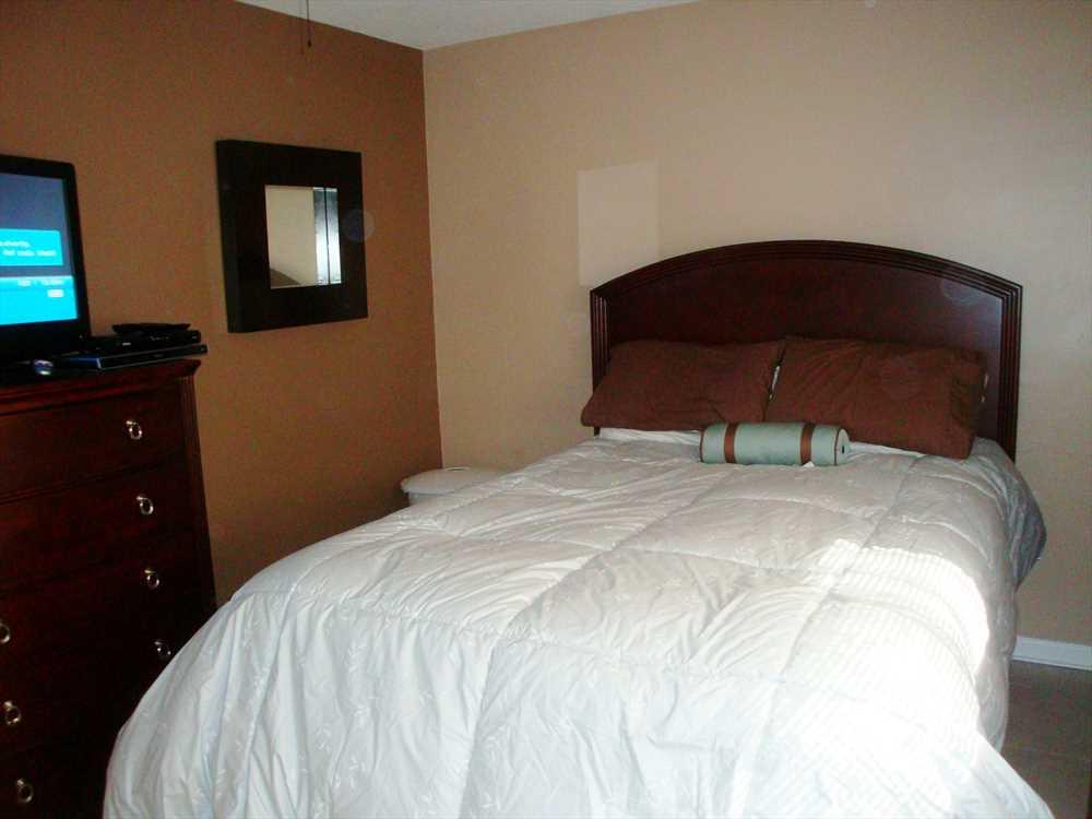 Second bedroom has queen bed and HDTV.