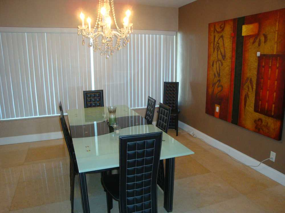Dining room has seating for up to eight.