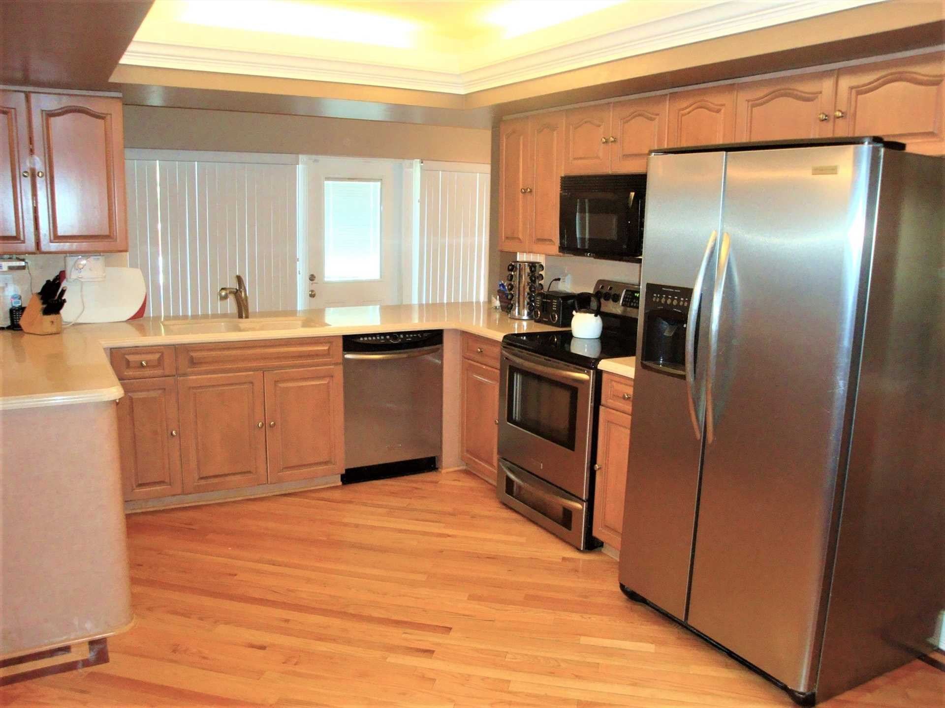 Kitchen opens to the door to the pool and deck area.