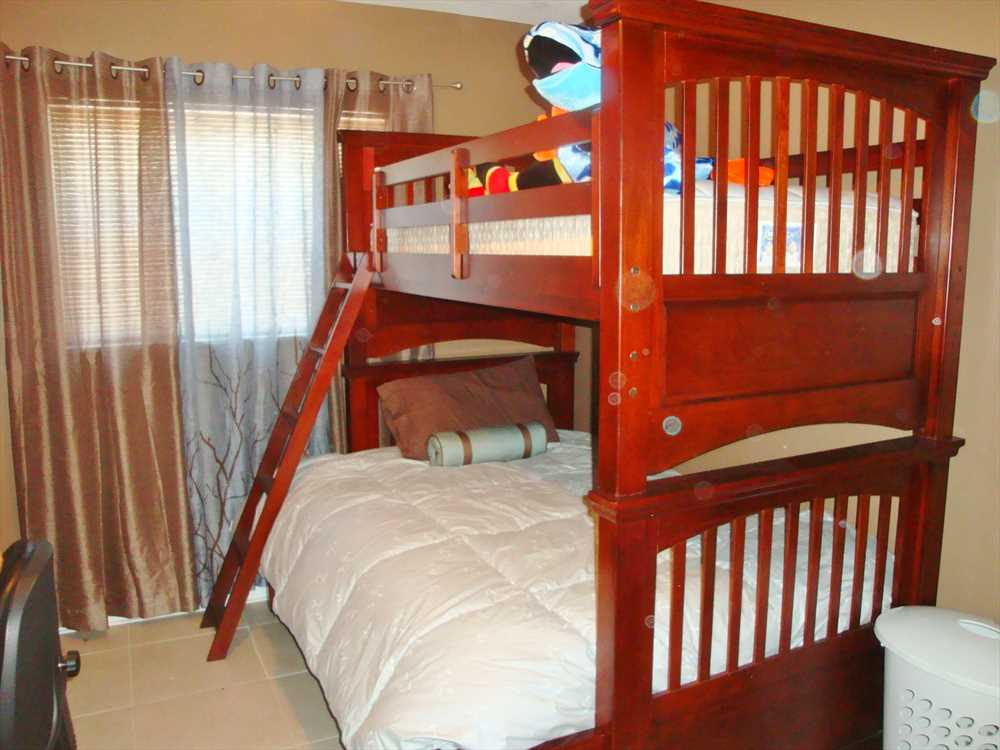 Fourth bedroom features bunk beds with a full size bottom an