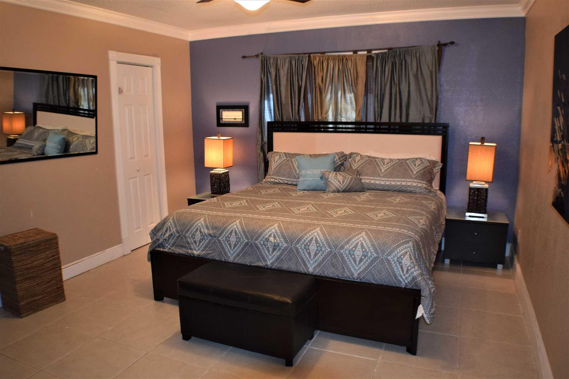 Master bedroom has king bed suite.
