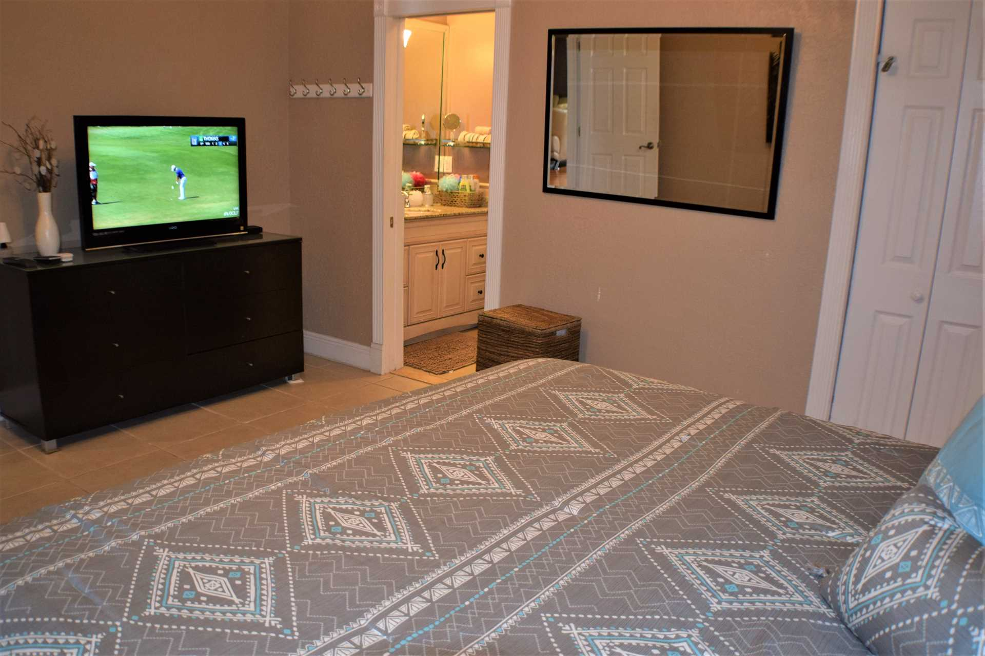 Master bedroom has ensuite bath and HDTV.