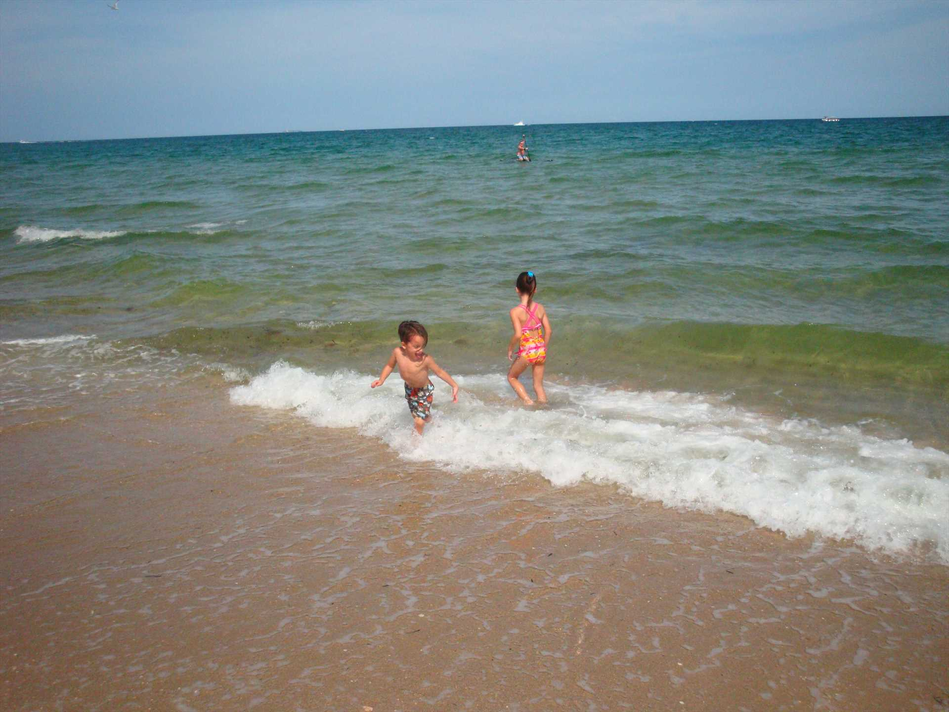 Watch your kids play in the surf of the shallow beach.