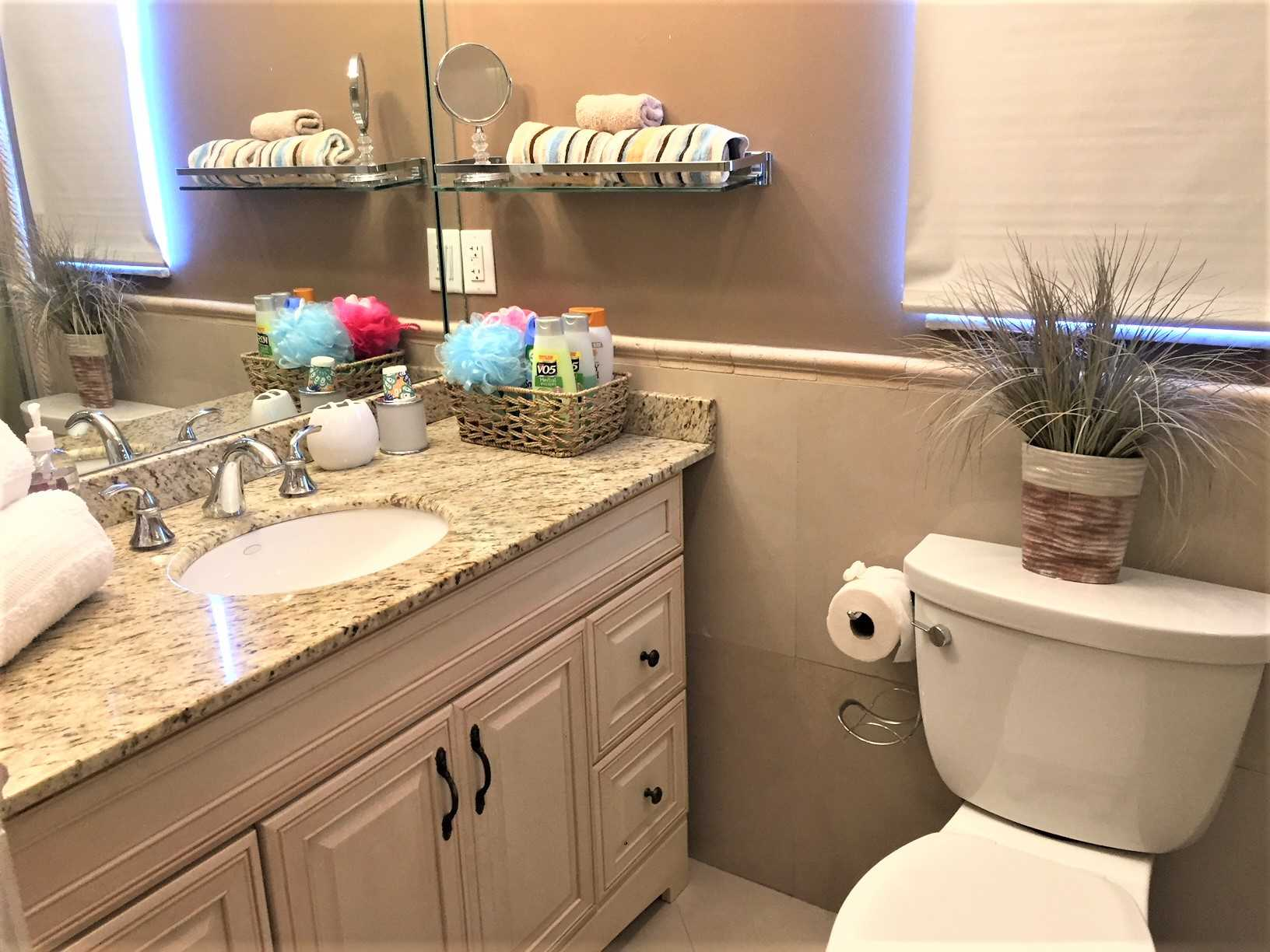 Master bath has granite countertop.