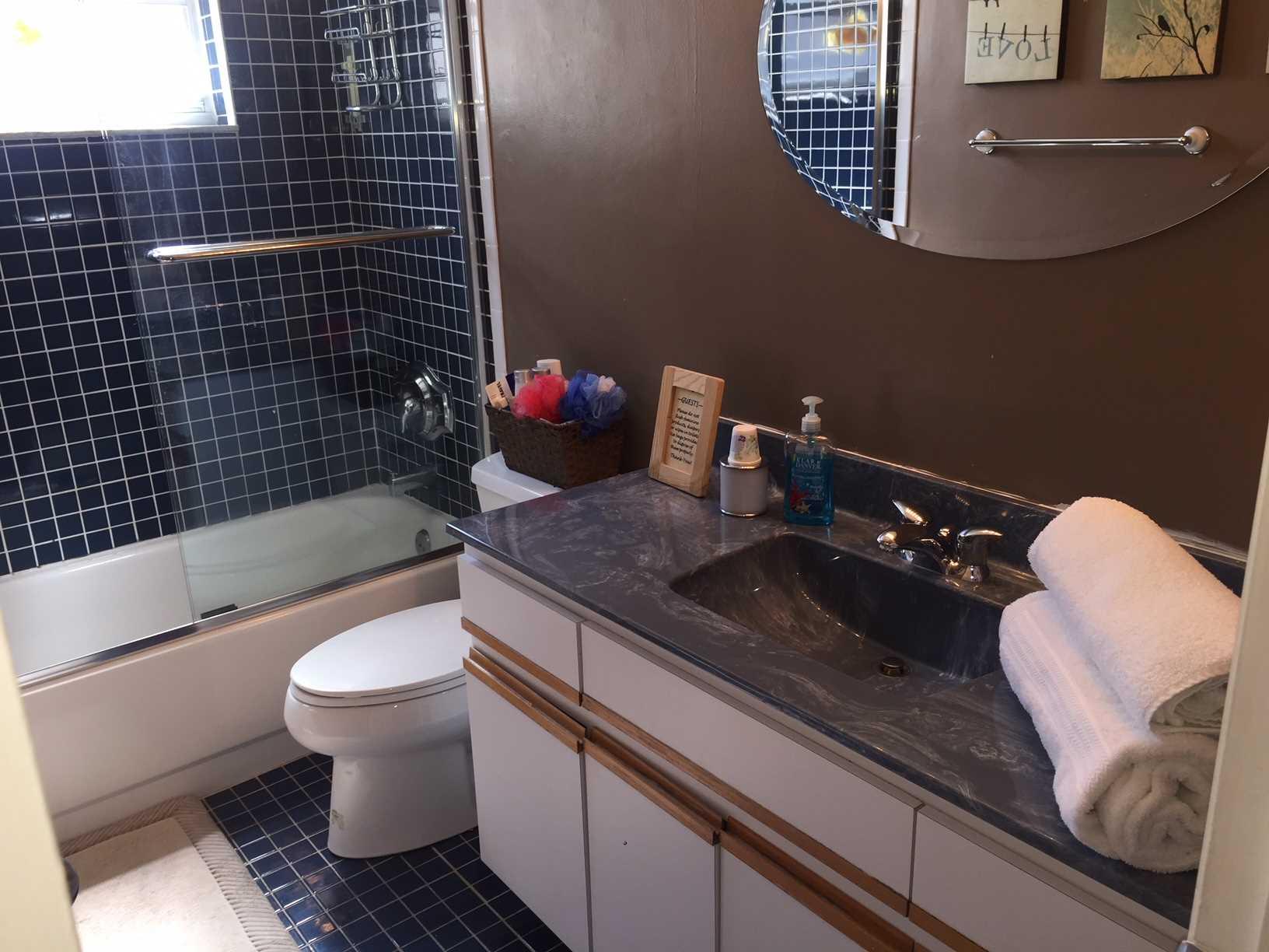 Main bath has combination tub and shower.
