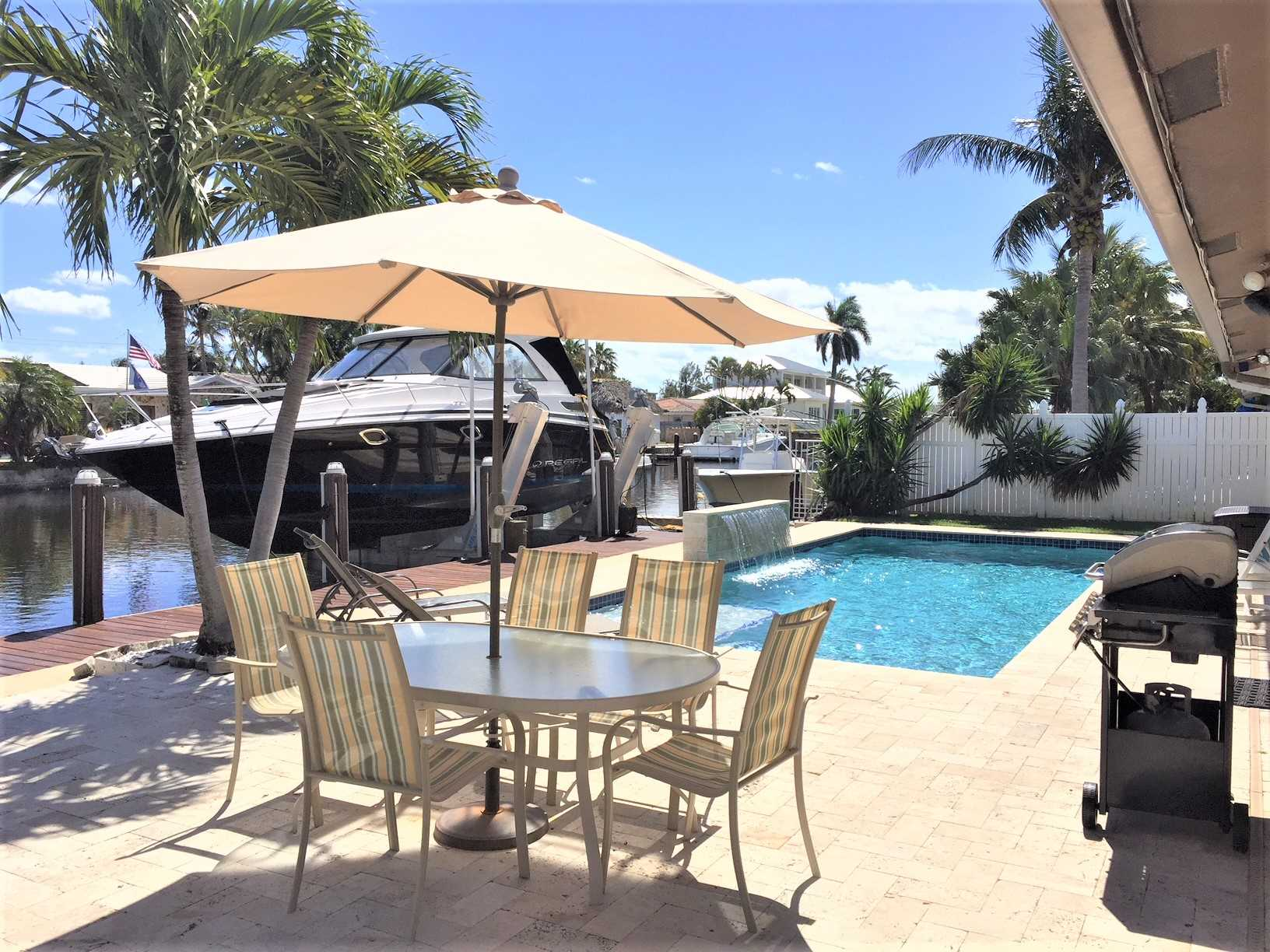 Live the South Florida lifestyle beside the sparkling pool a