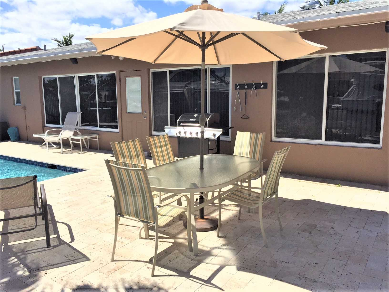 The new pool deck has BBQ and ample seating for a large fami