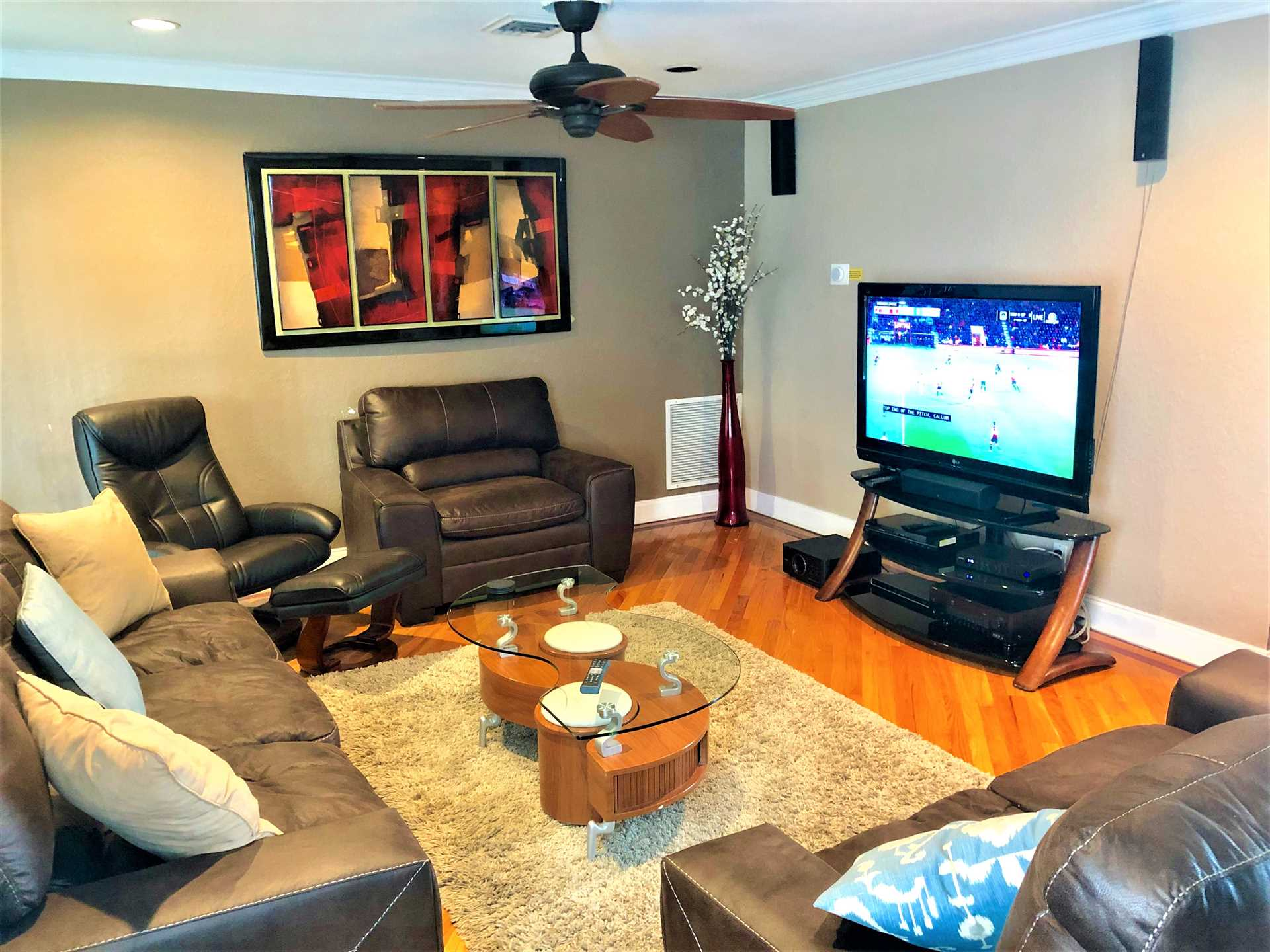 Spacious living room has ample seating and an HDTV.