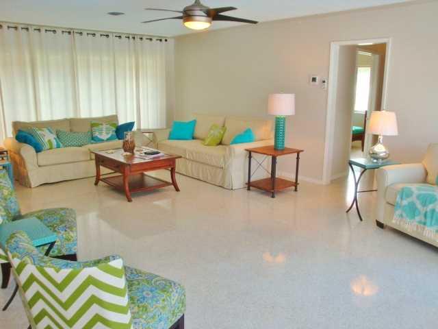 Huge open living room has queen and twin sofa beds