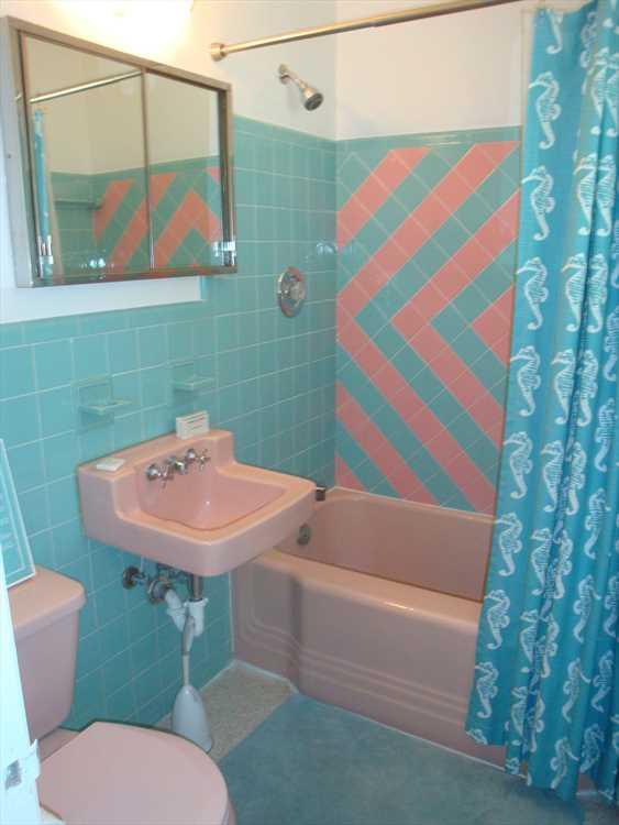 Master bath retains retro look and has combination tub and s