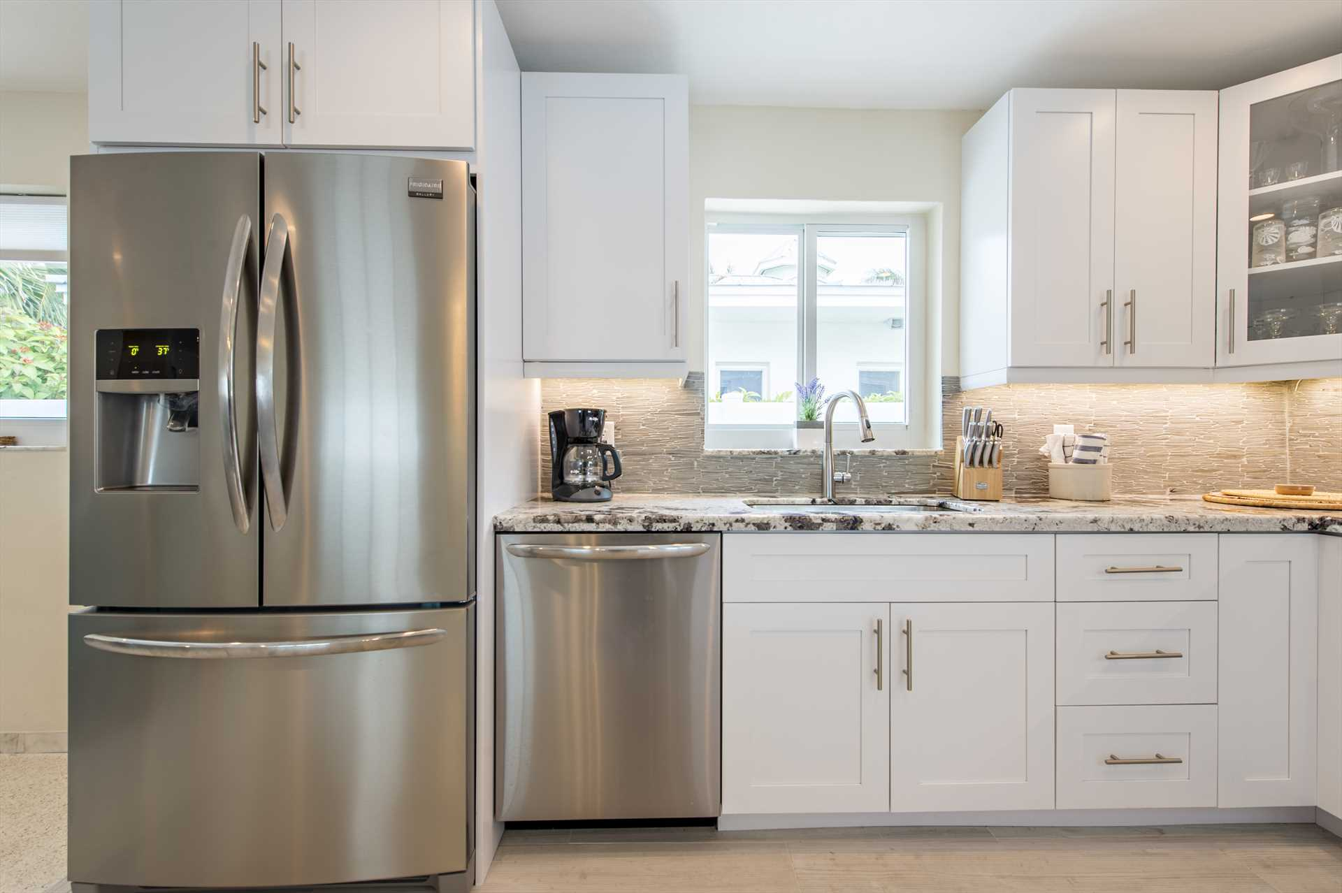 Fully equipped kitchen has all new stainless appliances and