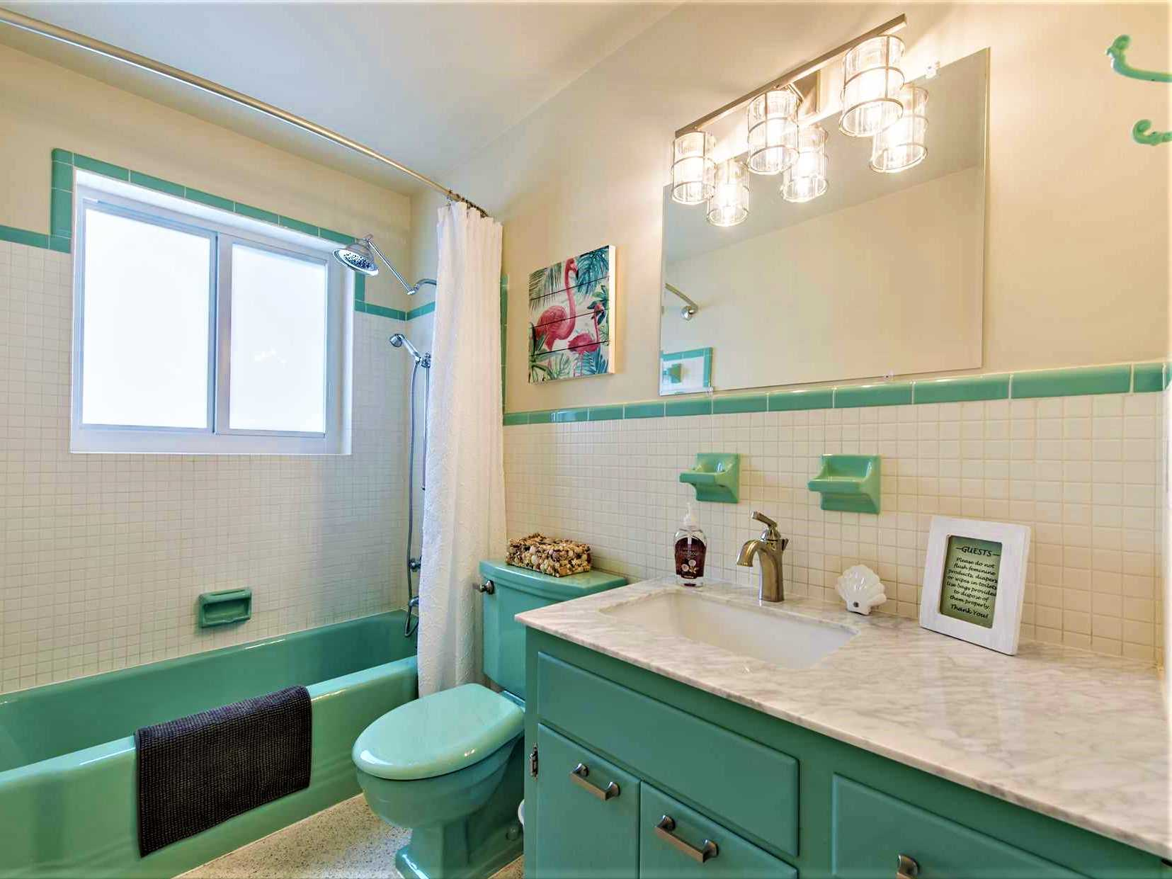Updated main bath has also retained the retro look.