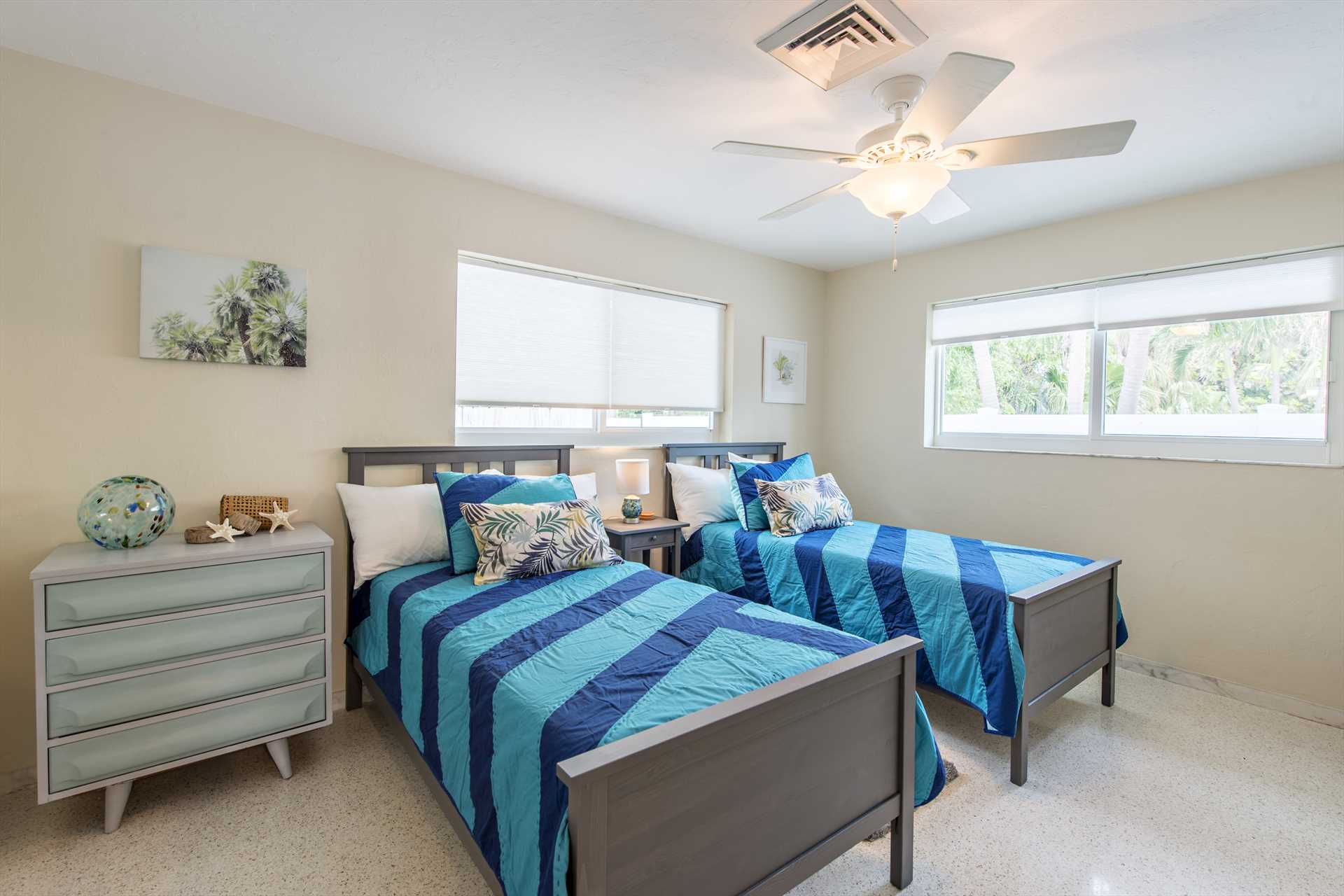 Comfortable twin bedroom has large walk in closet.