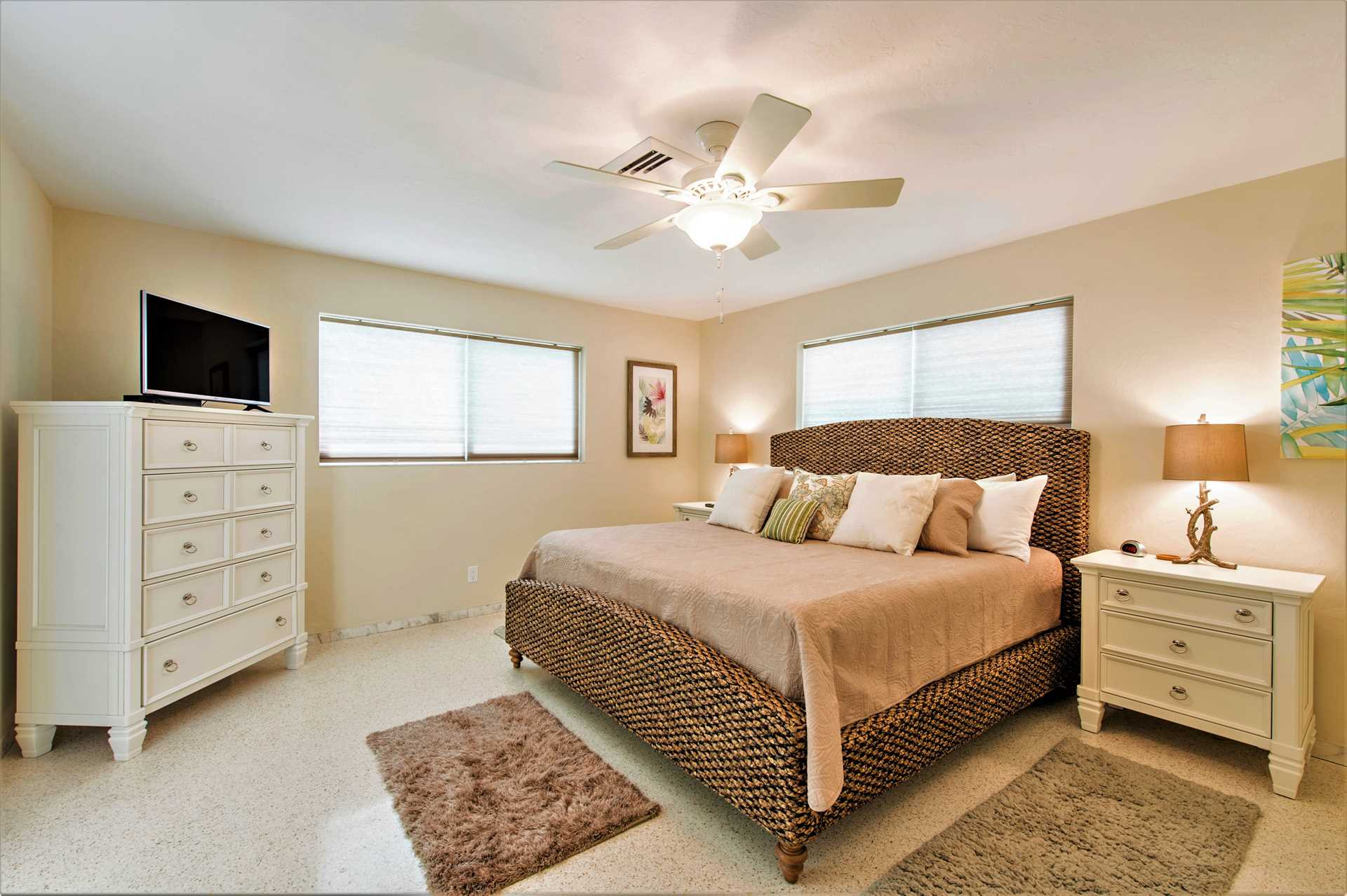 Master bedroom has king bed and ensuite cabana bath.