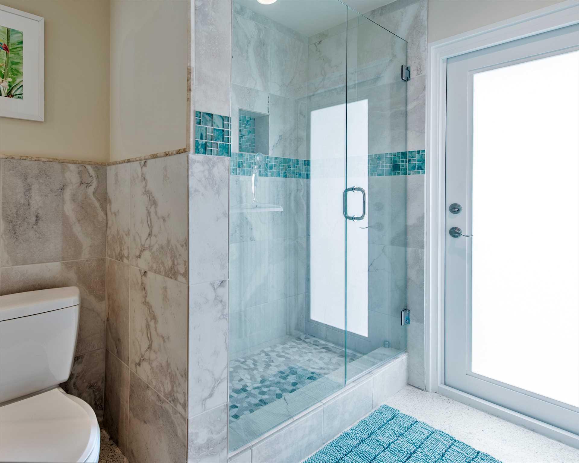 Master bath has huge walk in shower plus cabana door to pool