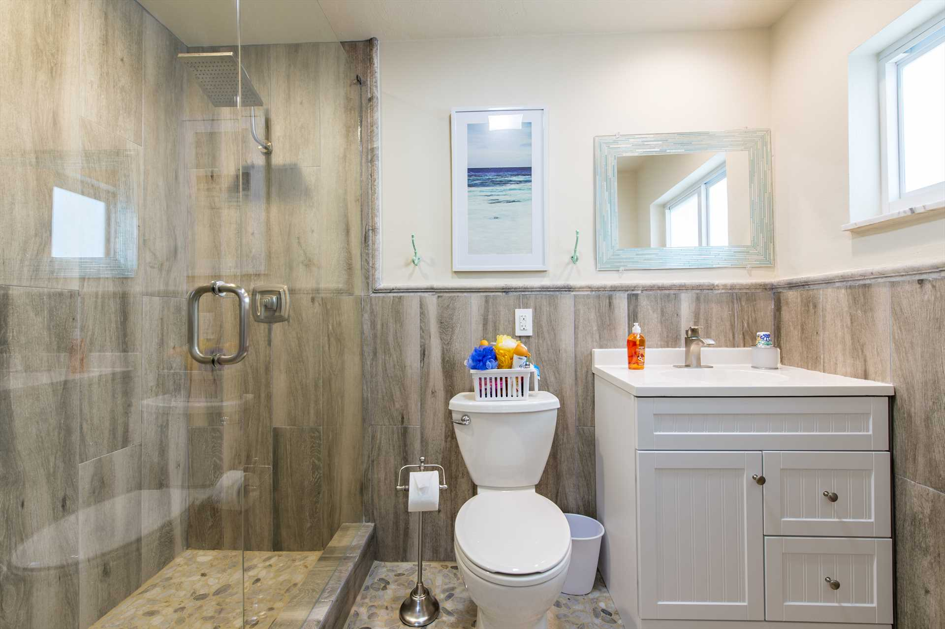 Third bedroom ensuite bath features glass shower.