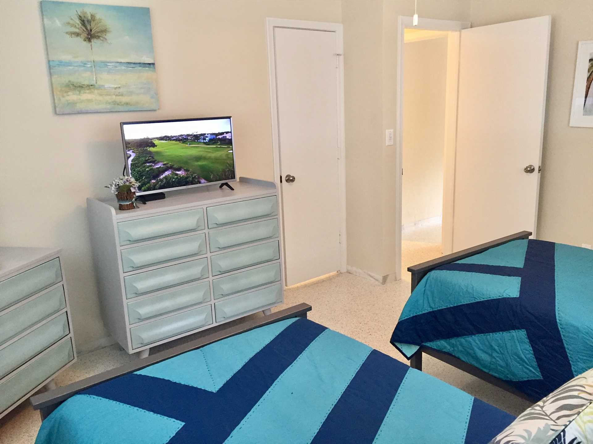 Twin bedroom has HDTV and private bath entrance.
