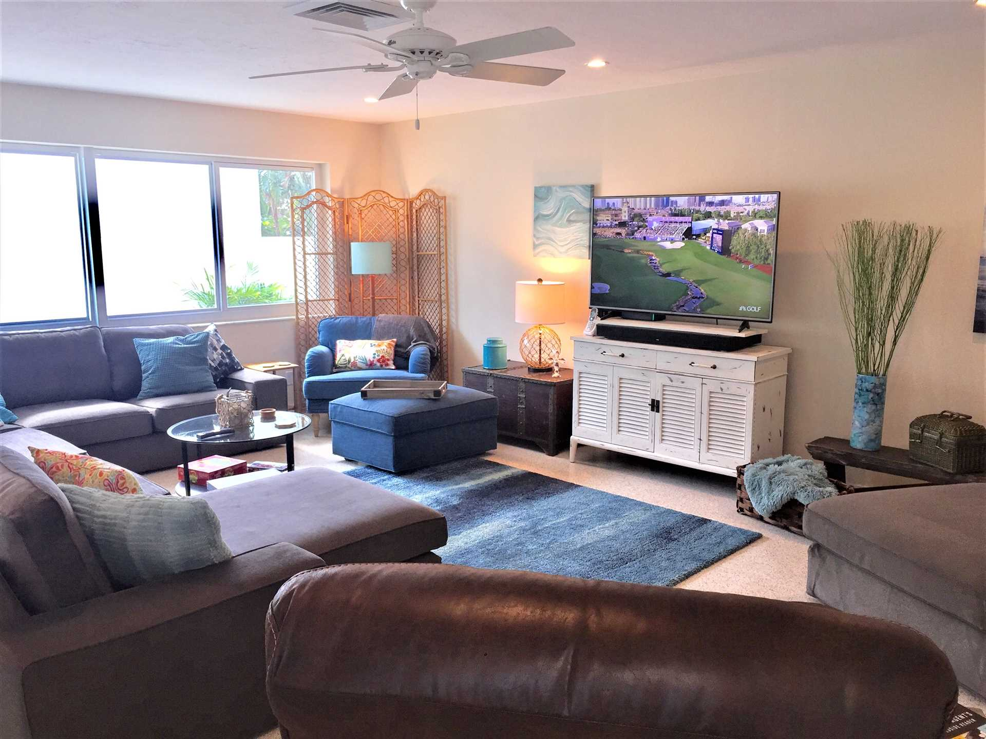 """Huge open living area features 55"""" HDTV with DVD."""
