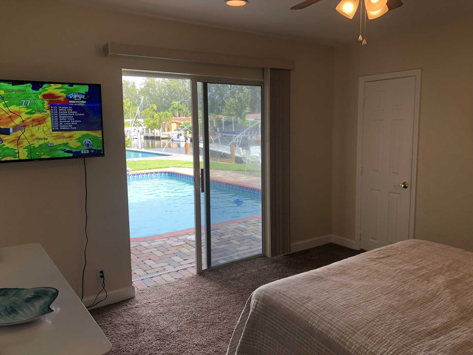 Master bedroom opens to the pool deck.