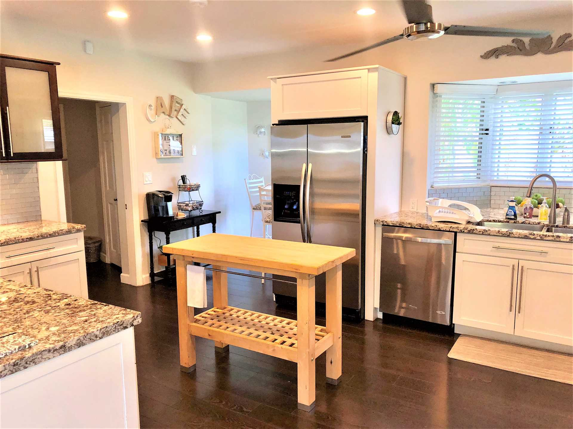 Spacious kitchen with food preparation island has every appl