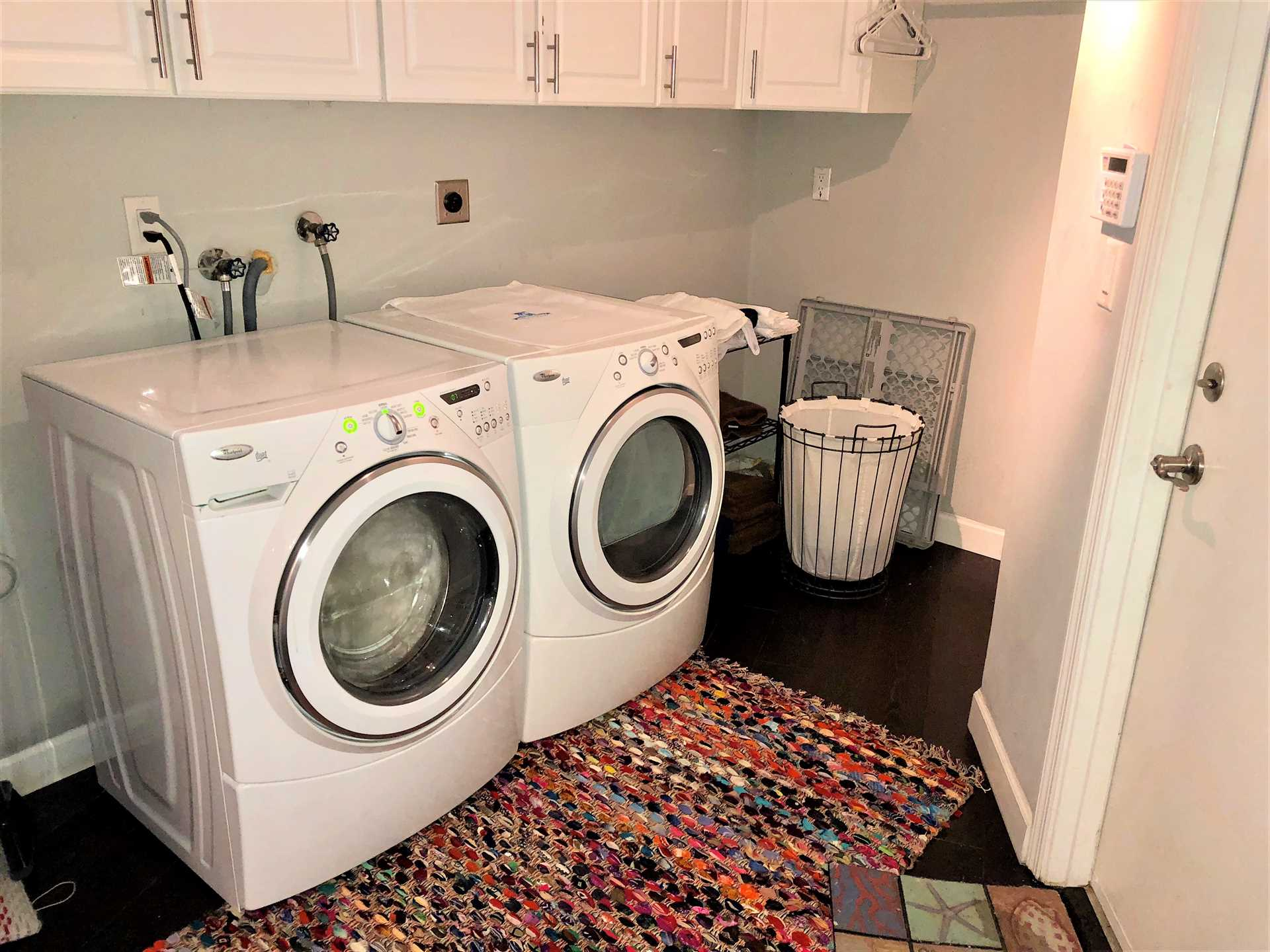 Utility room off kitchen has new washer and dryer.