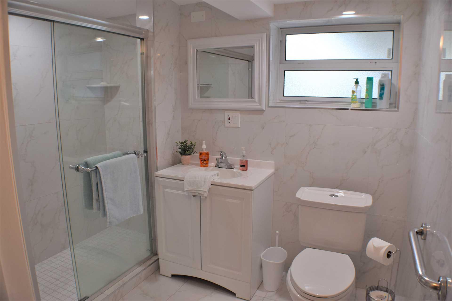 Ensuite bathroom has a walk in shower.