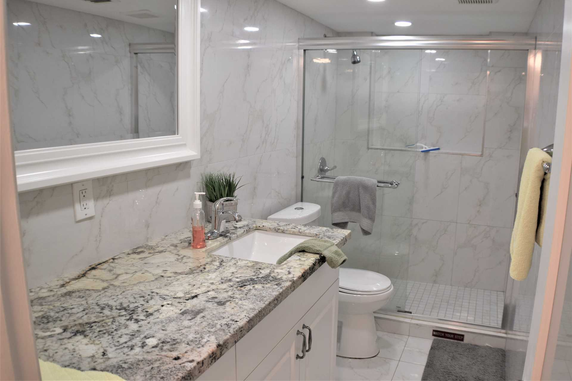 Main bath has marble countertops and walk in shower.
