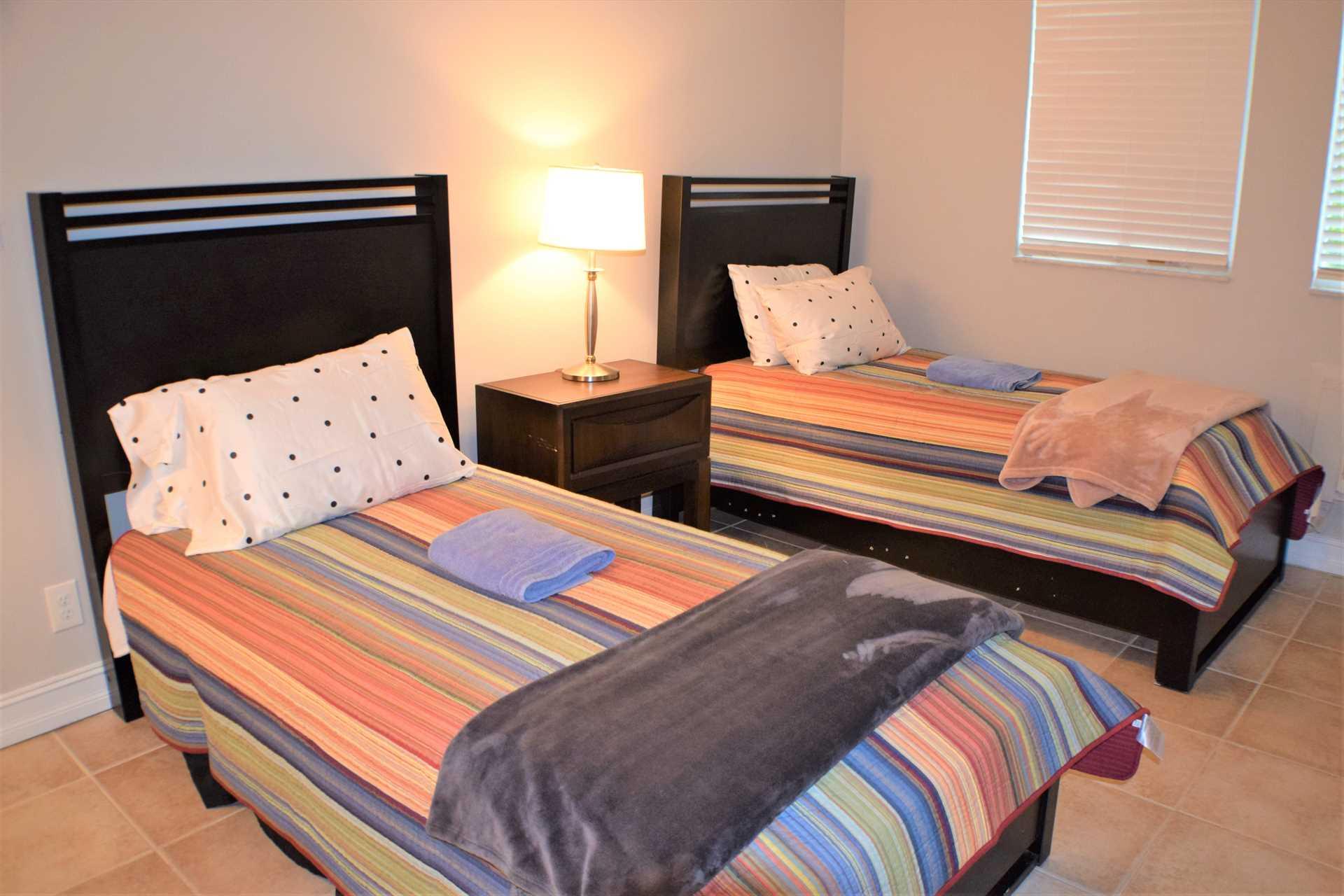 Second bedroom has twin beds.