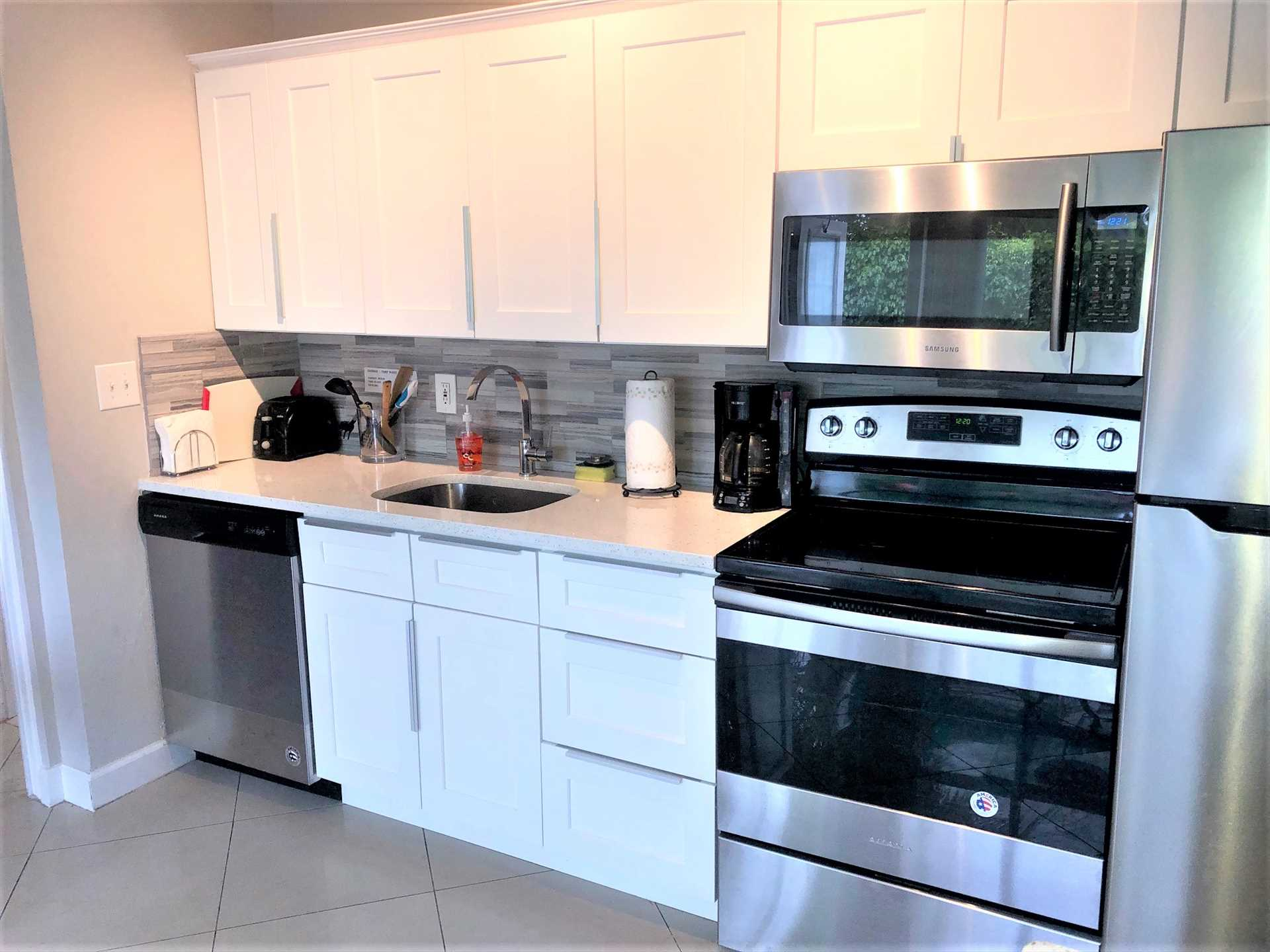 Kitchen has all new stainless appliances.