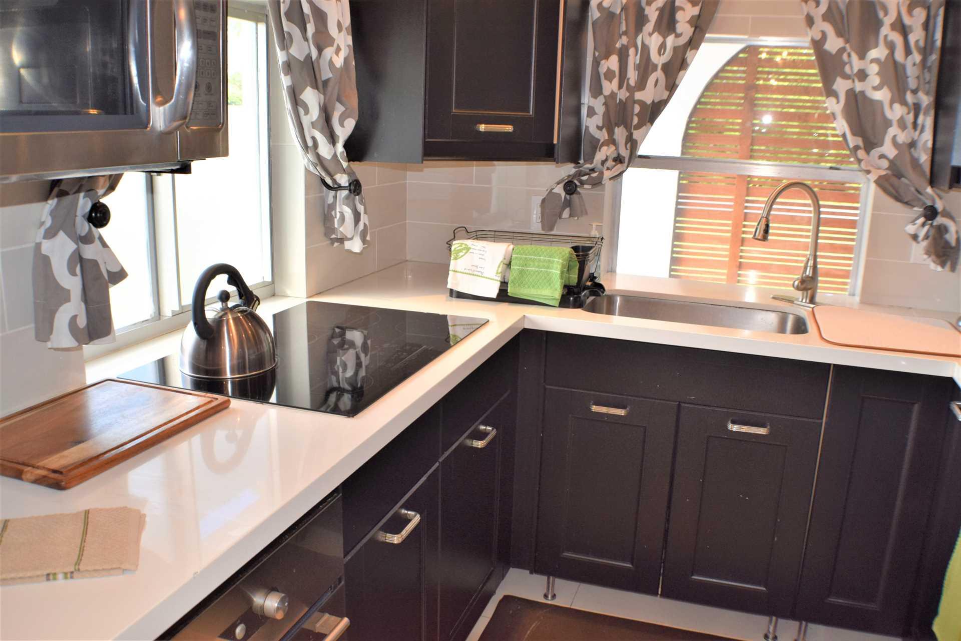 Kitchen features built-in cook top.