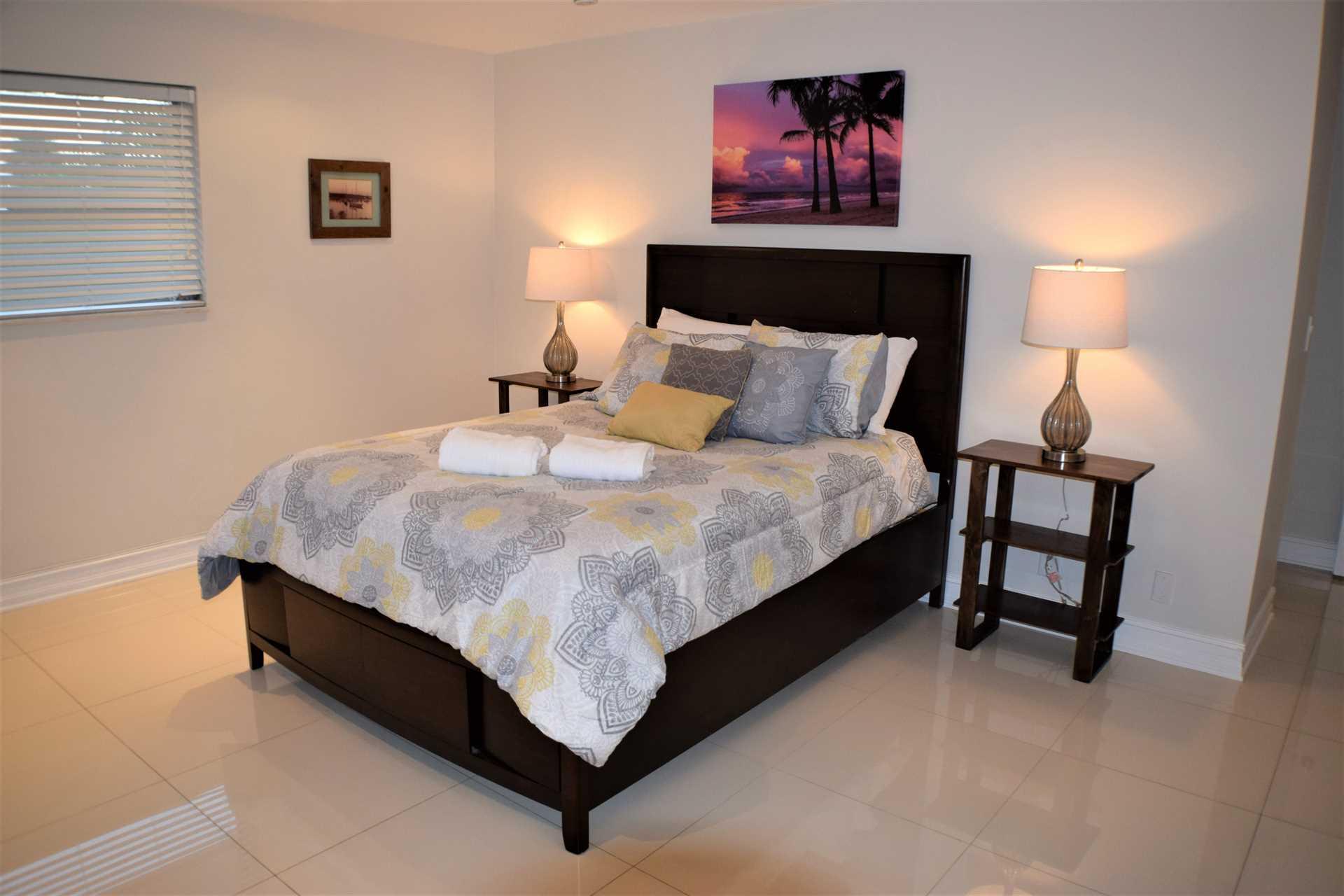 Spacious master bedroom on second floor has queen bed.