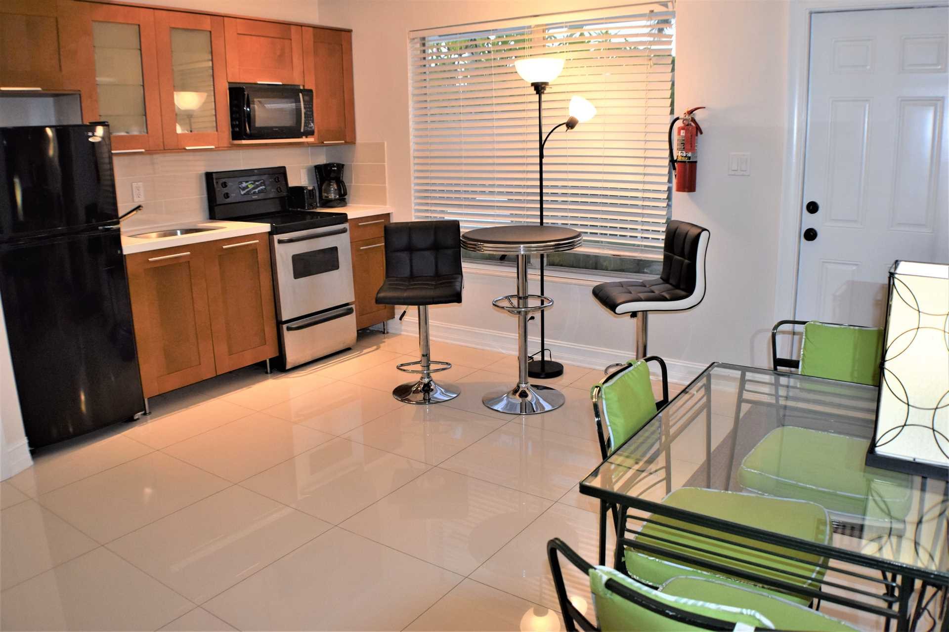 Kitchen area also has full set of cooking and dining impleme